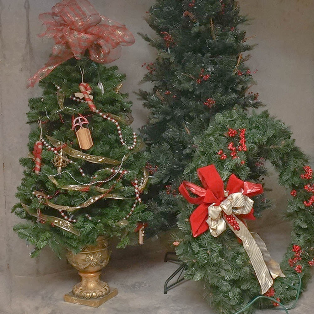 Faux Christmas Trees and a Large Wreath