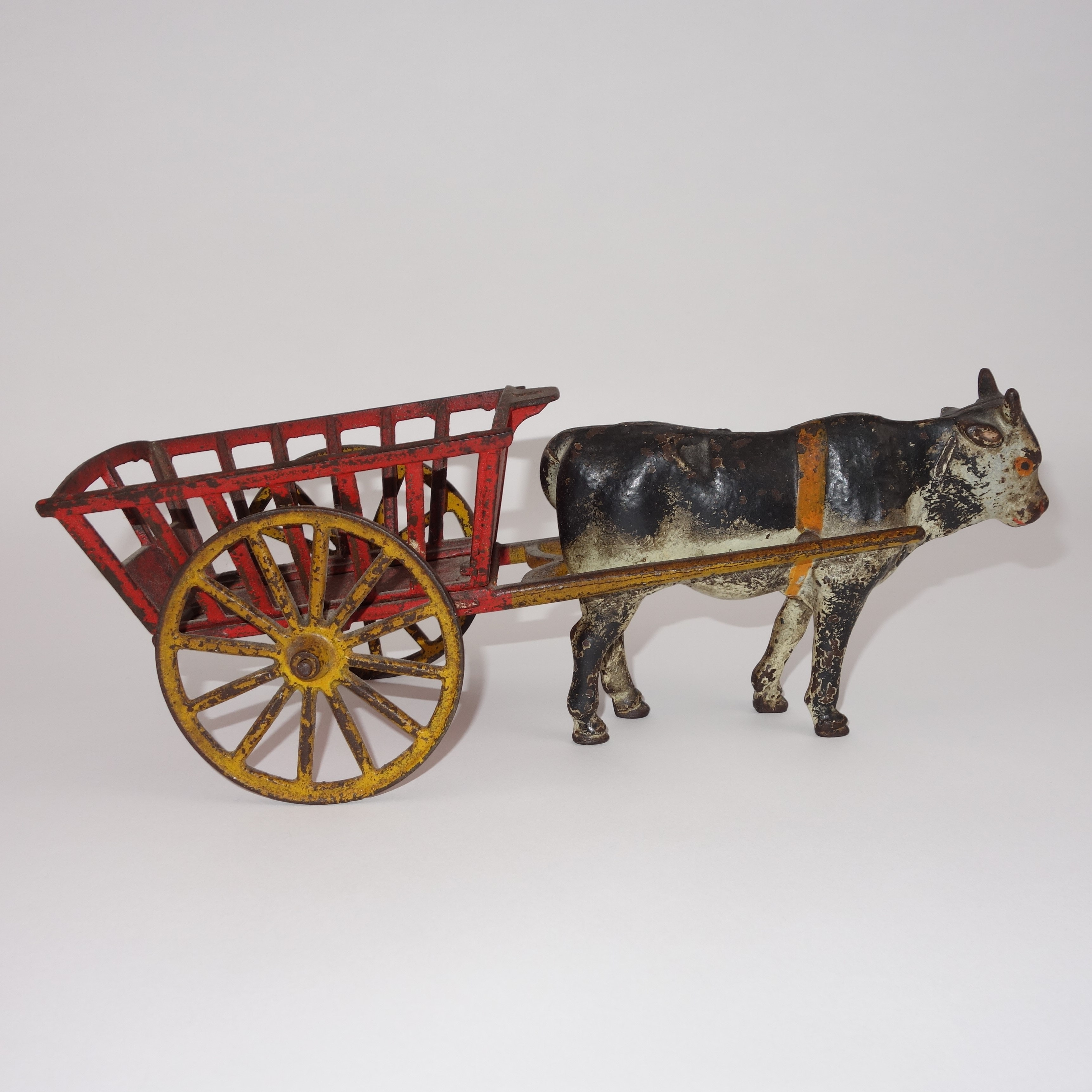 Antique Cast Iron Cow Pulling Cart
