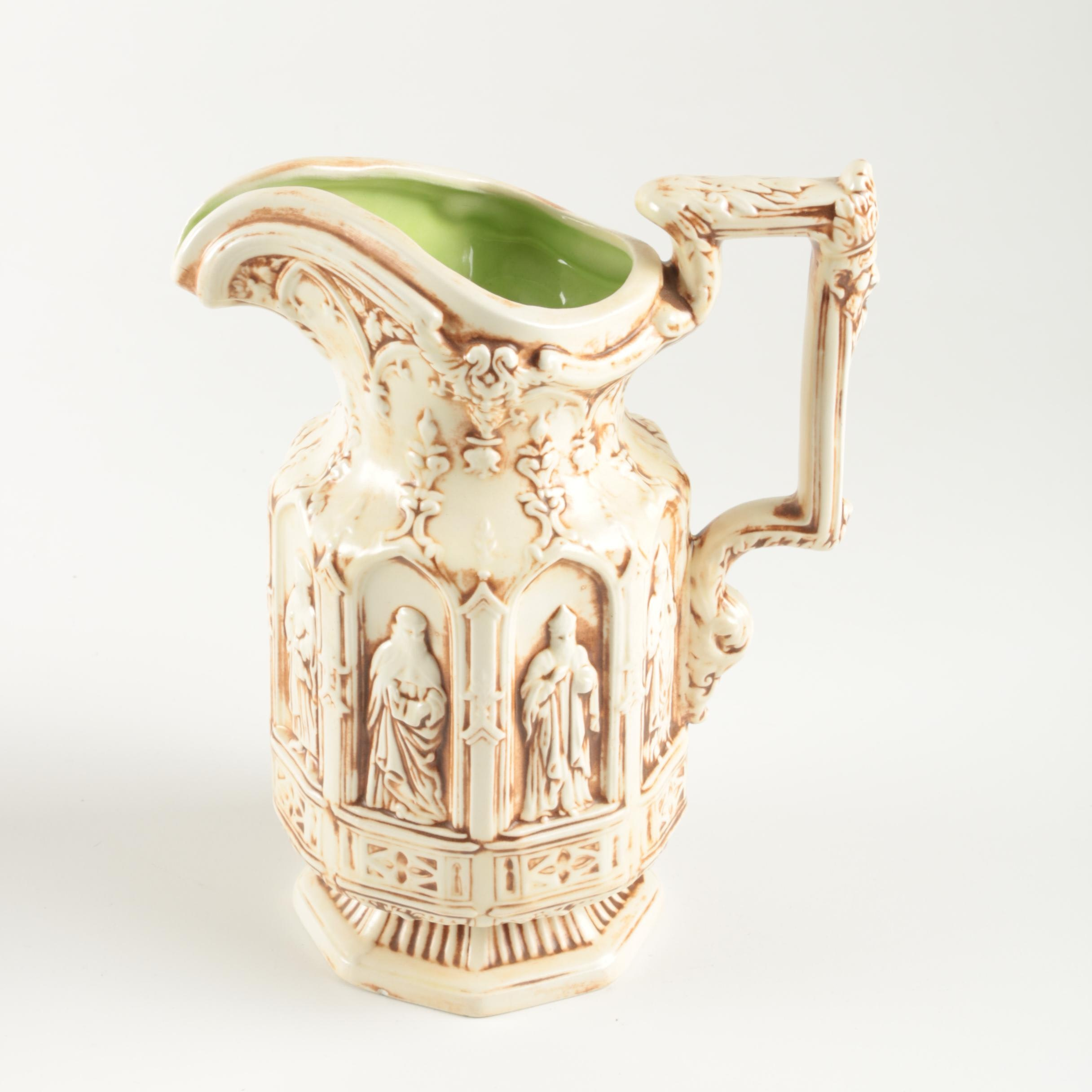 Signed Ceramic Pitcher with Iconographic Motif