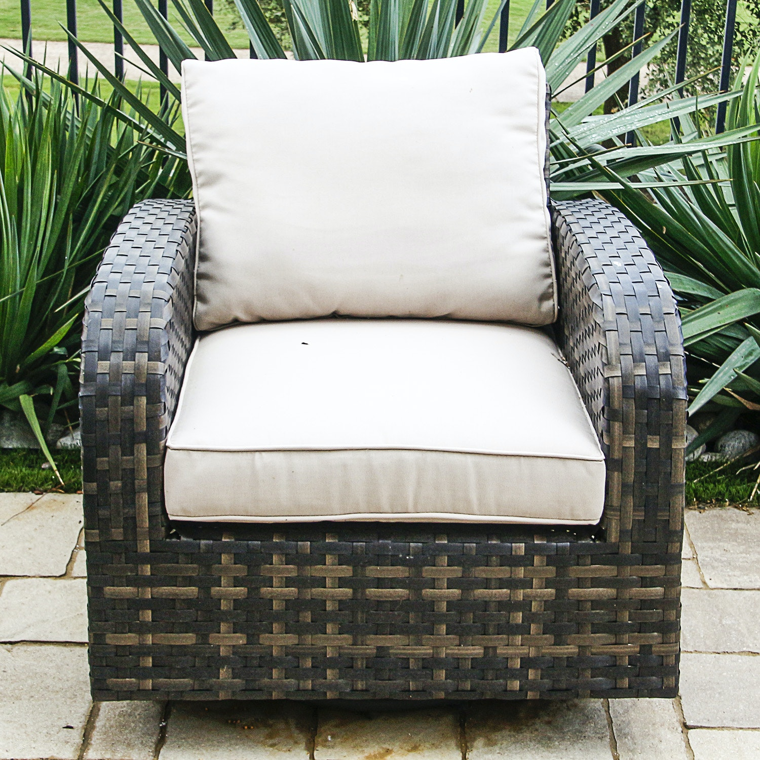 Brown Woven Patio Chair with Cream Upholstered Cushions