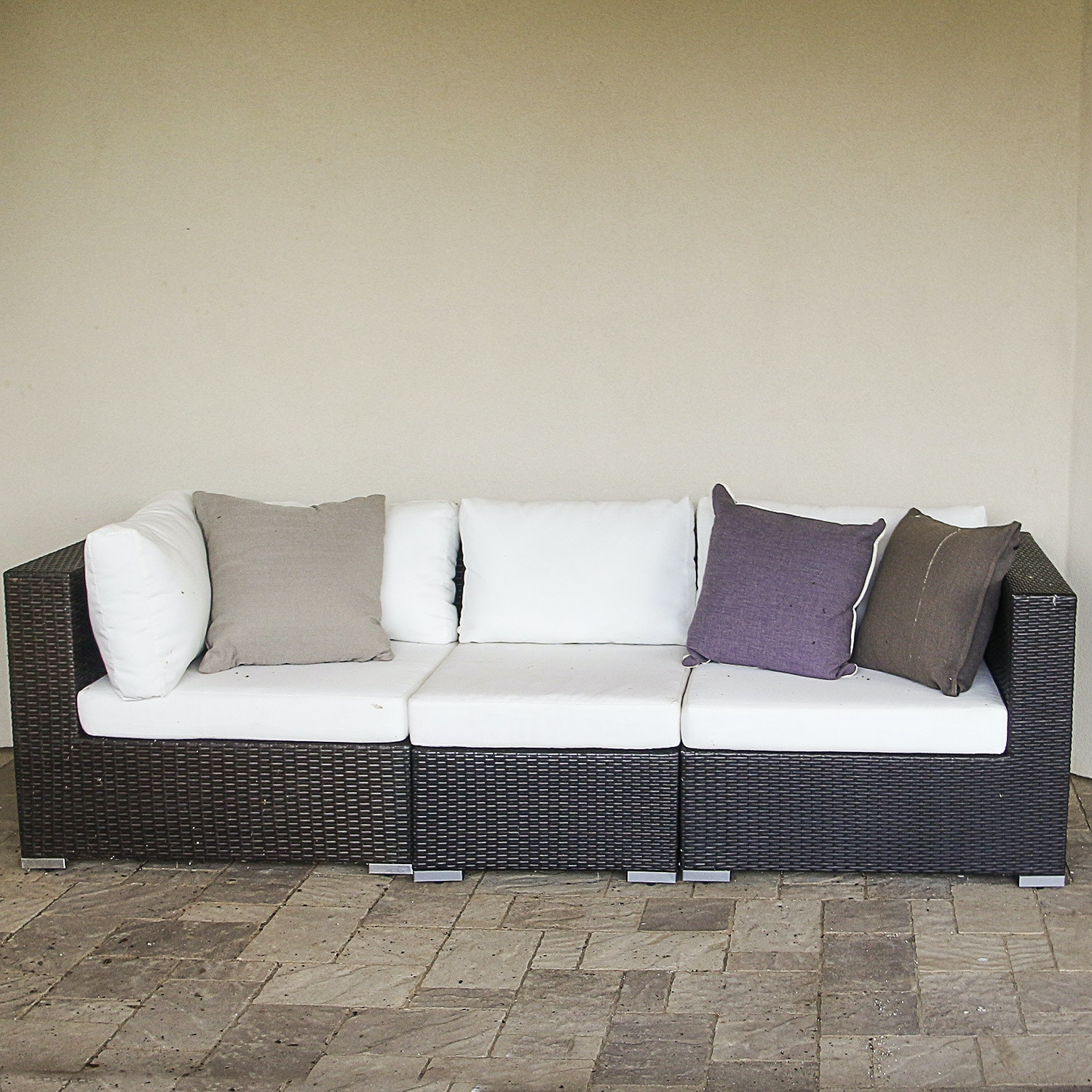 Brown Faux Wicker Sectional with White Upholstered Cushions
