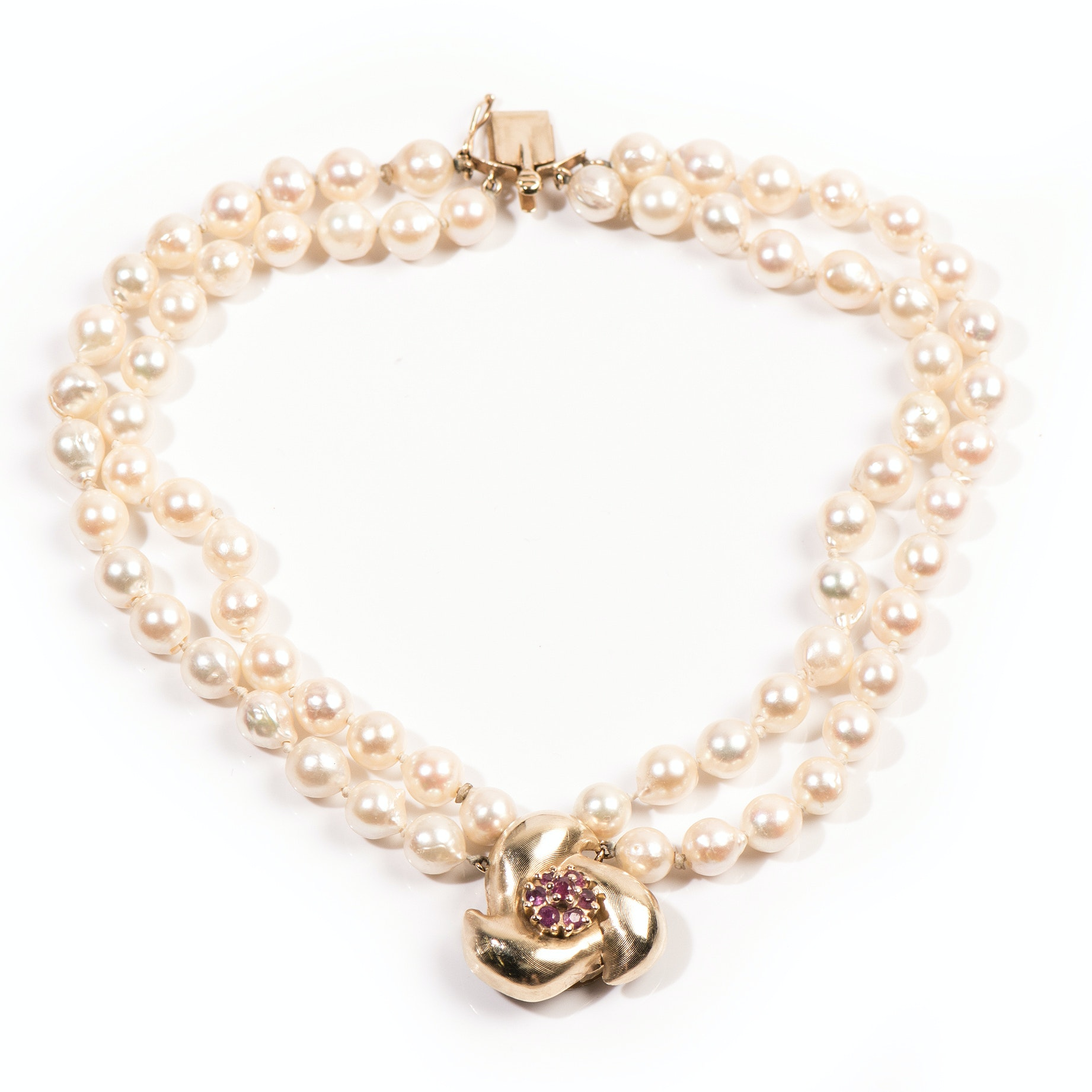 Double Strand Baroque Pearl Bracelet with a 14K Yellow Gold Clasp with Rubies