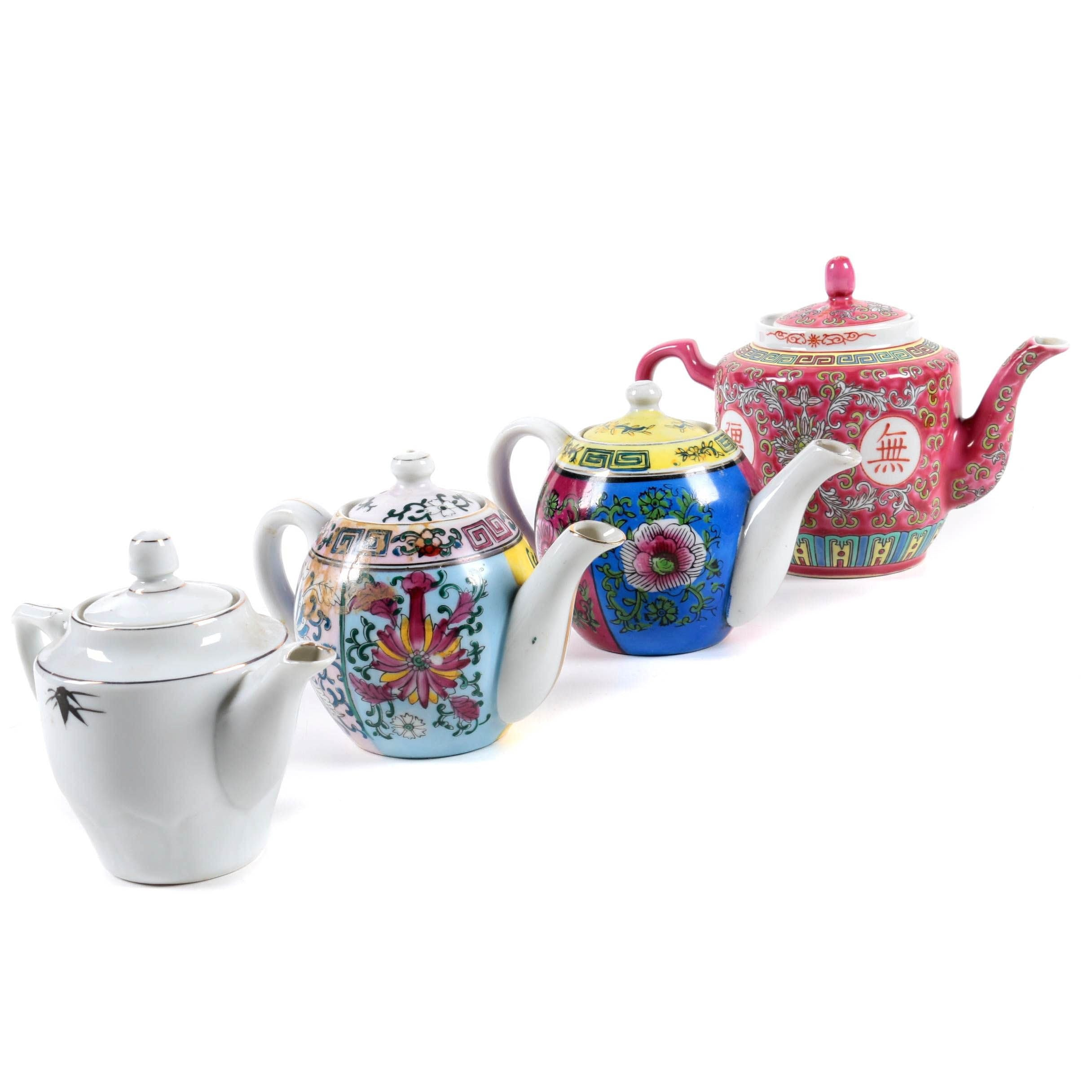 Four Chinese and Japanese Ceramic Teapots
