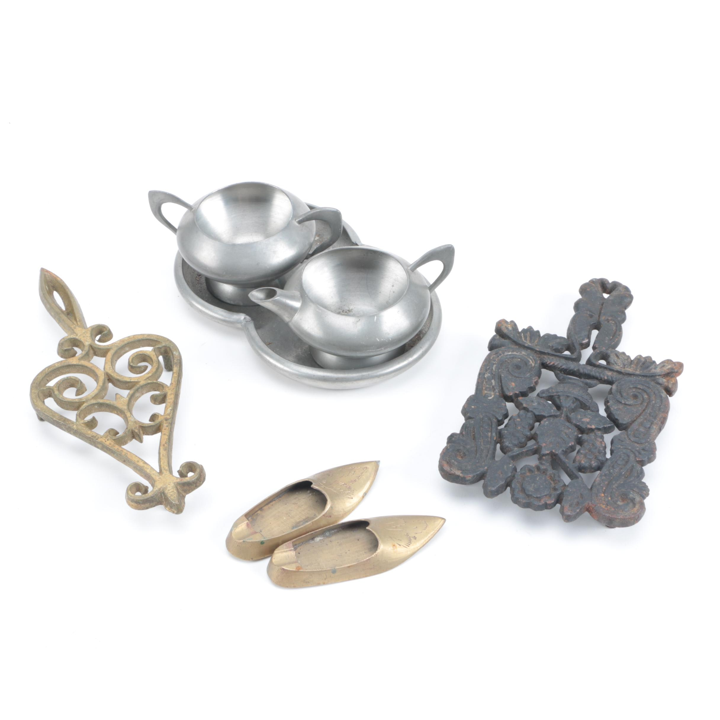 Mid-Century Pewter with Brass Trivets and Cast Iron