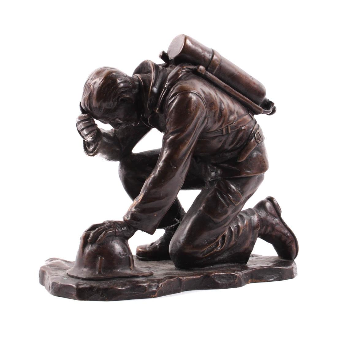 Kneeling Firefighter Bronze Sculpture