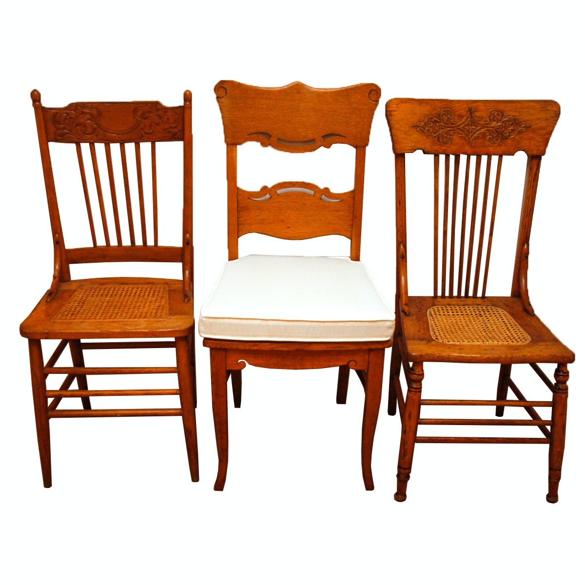 Assortment of Oak and Cane Dining Chairs
