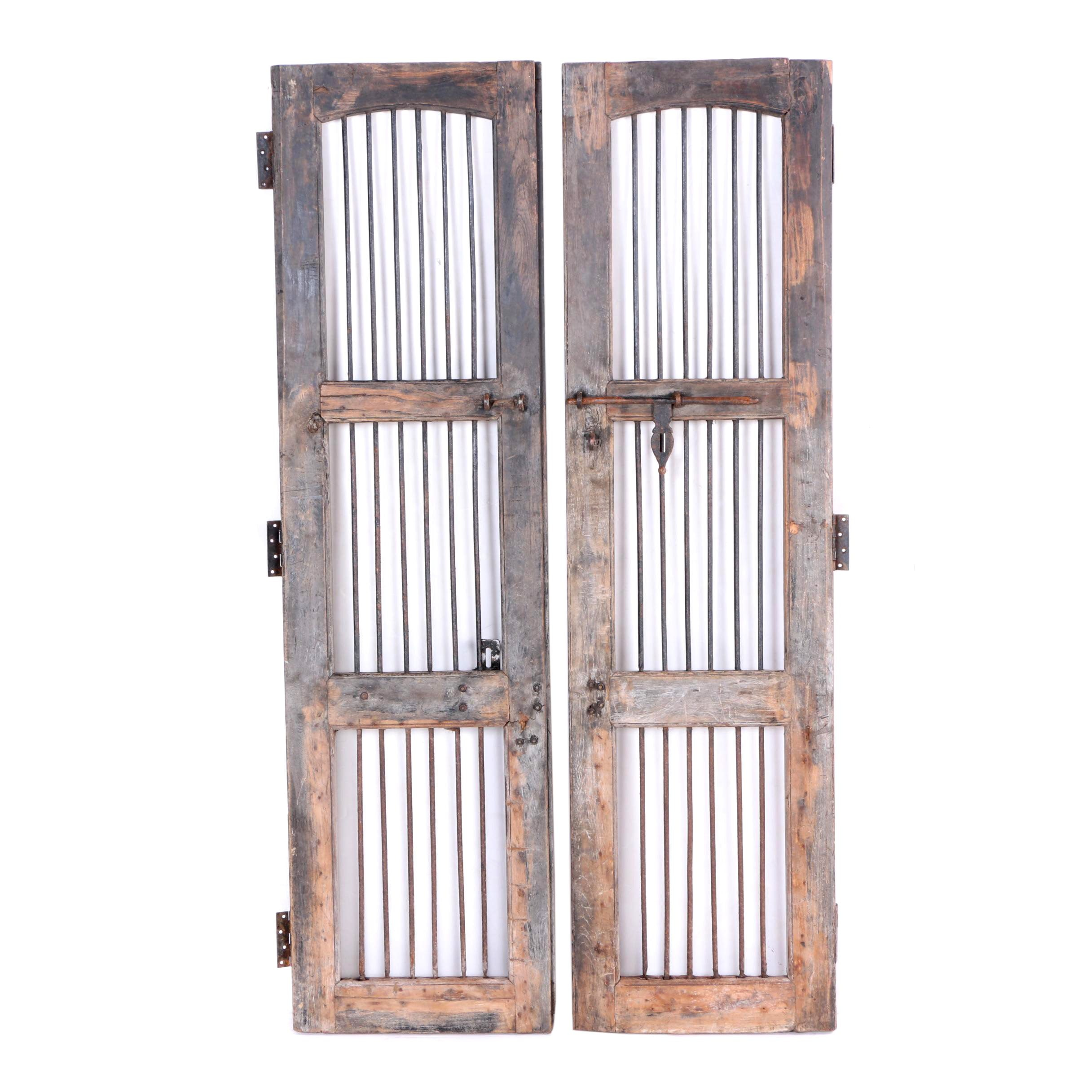 Pair of Antique Salvaged Doors With Rusted Bars