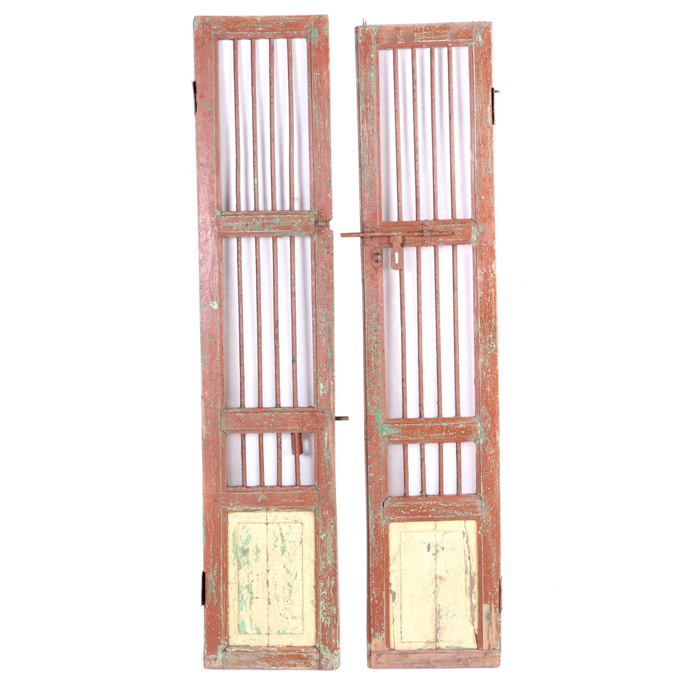Pair of Salvaged Painted Doors With Iron Bars and Raised Panels