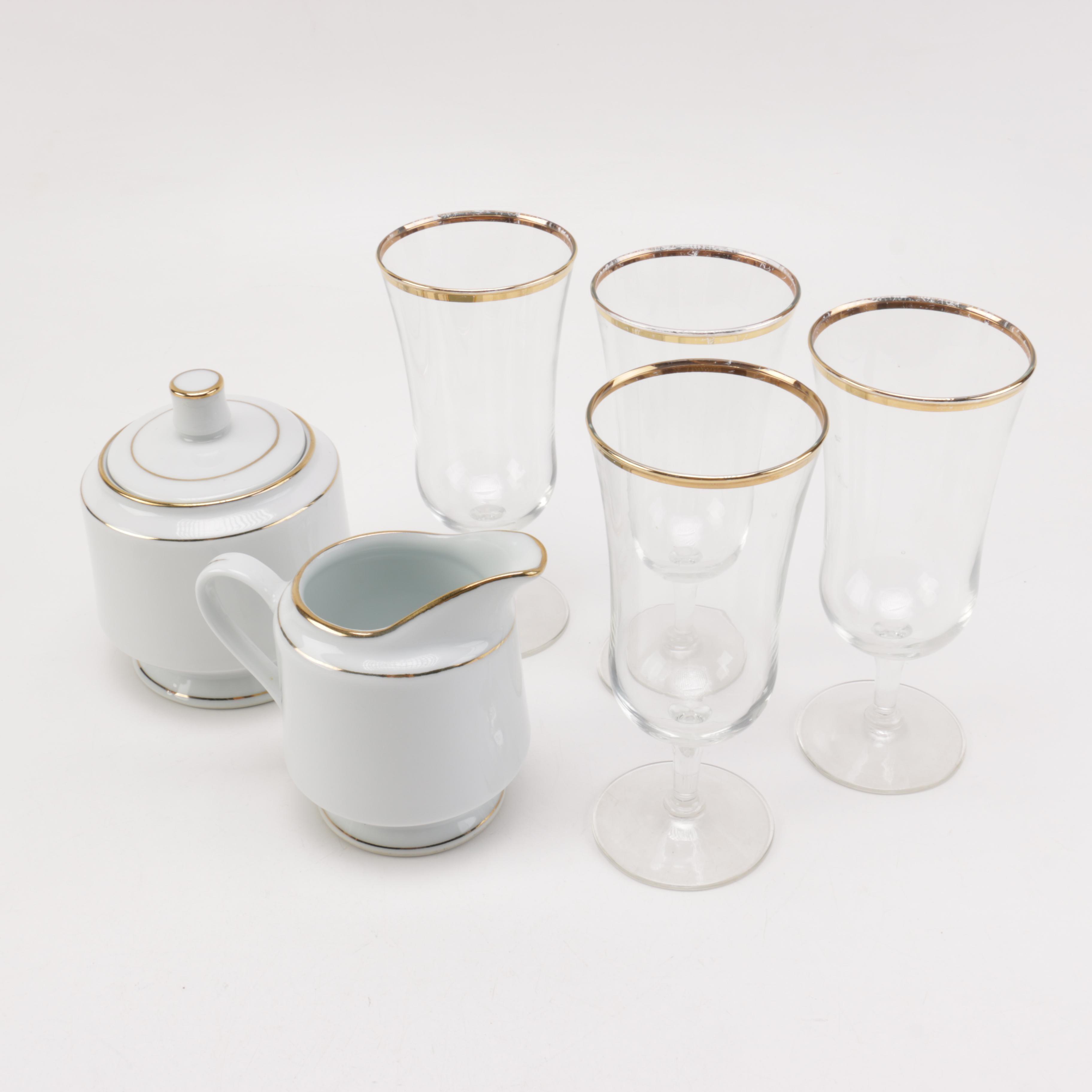 Gilt Trimmed Porcelain and Stemware