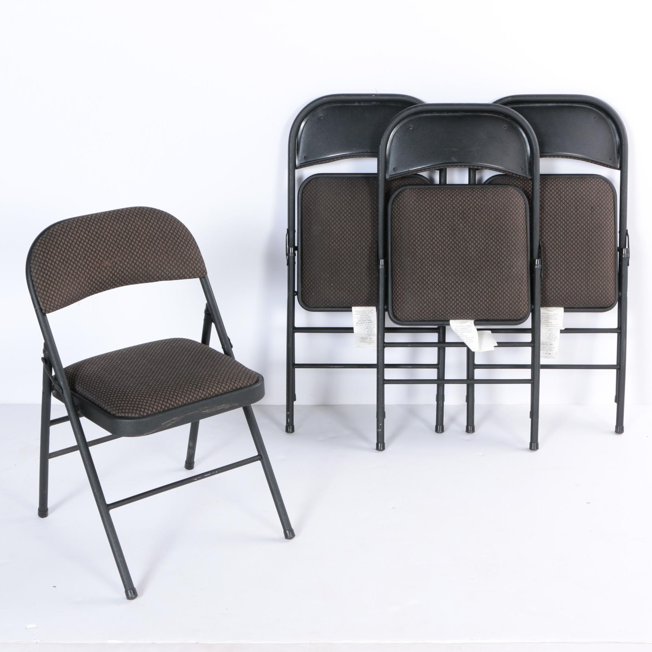 Four Padded Folding Chairs by Cosco