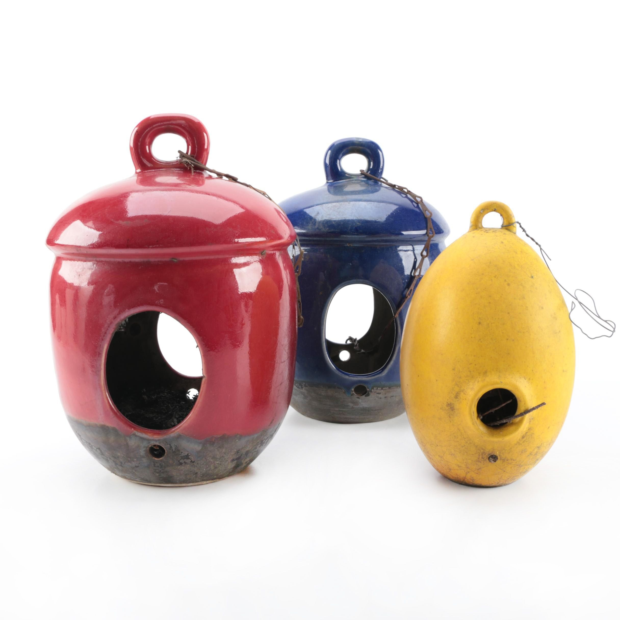 Blue, Red, and Yellow Ceramic Birdhouses
