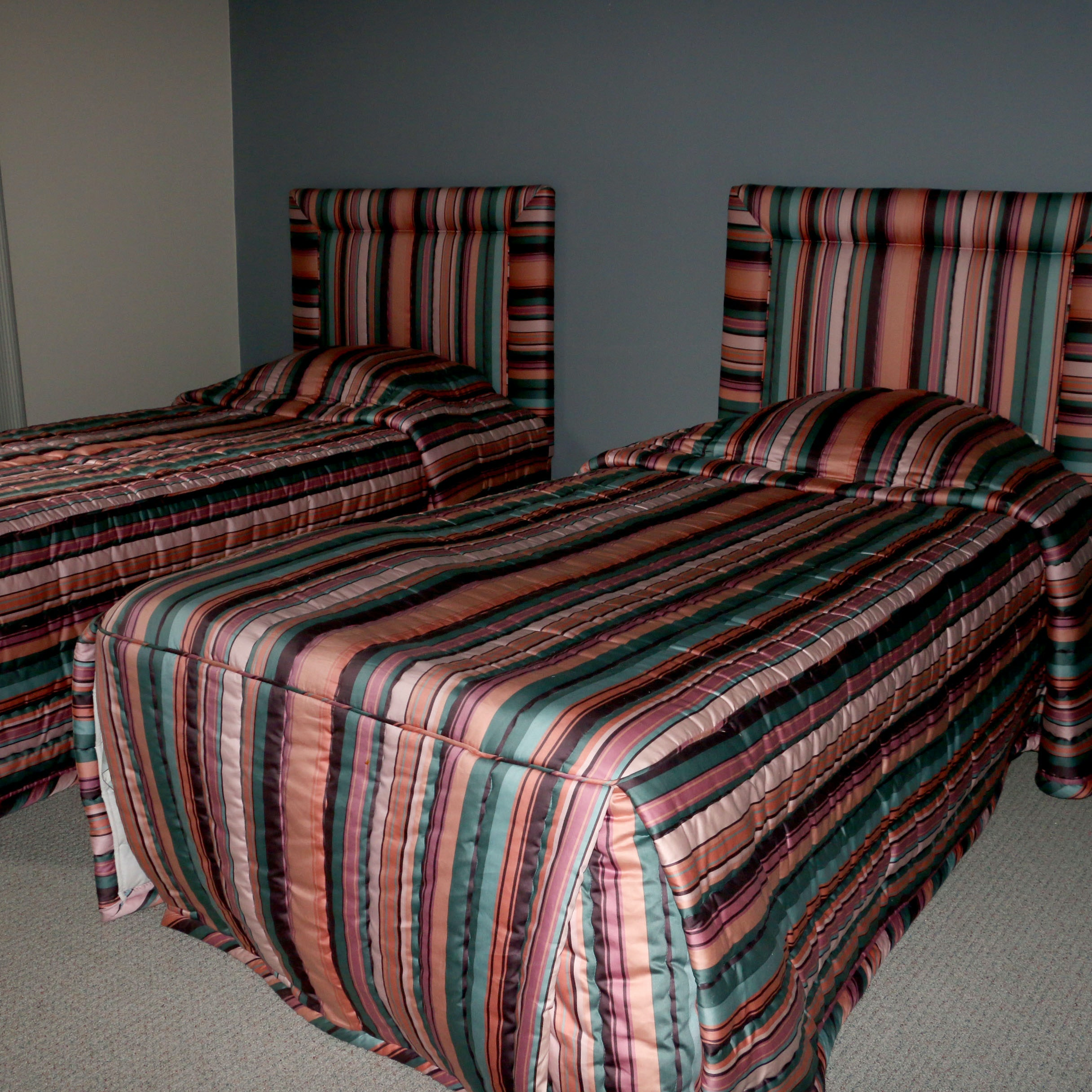 Pair of Upholstered Twin Sized Headboards with Bed Frames and Comforters