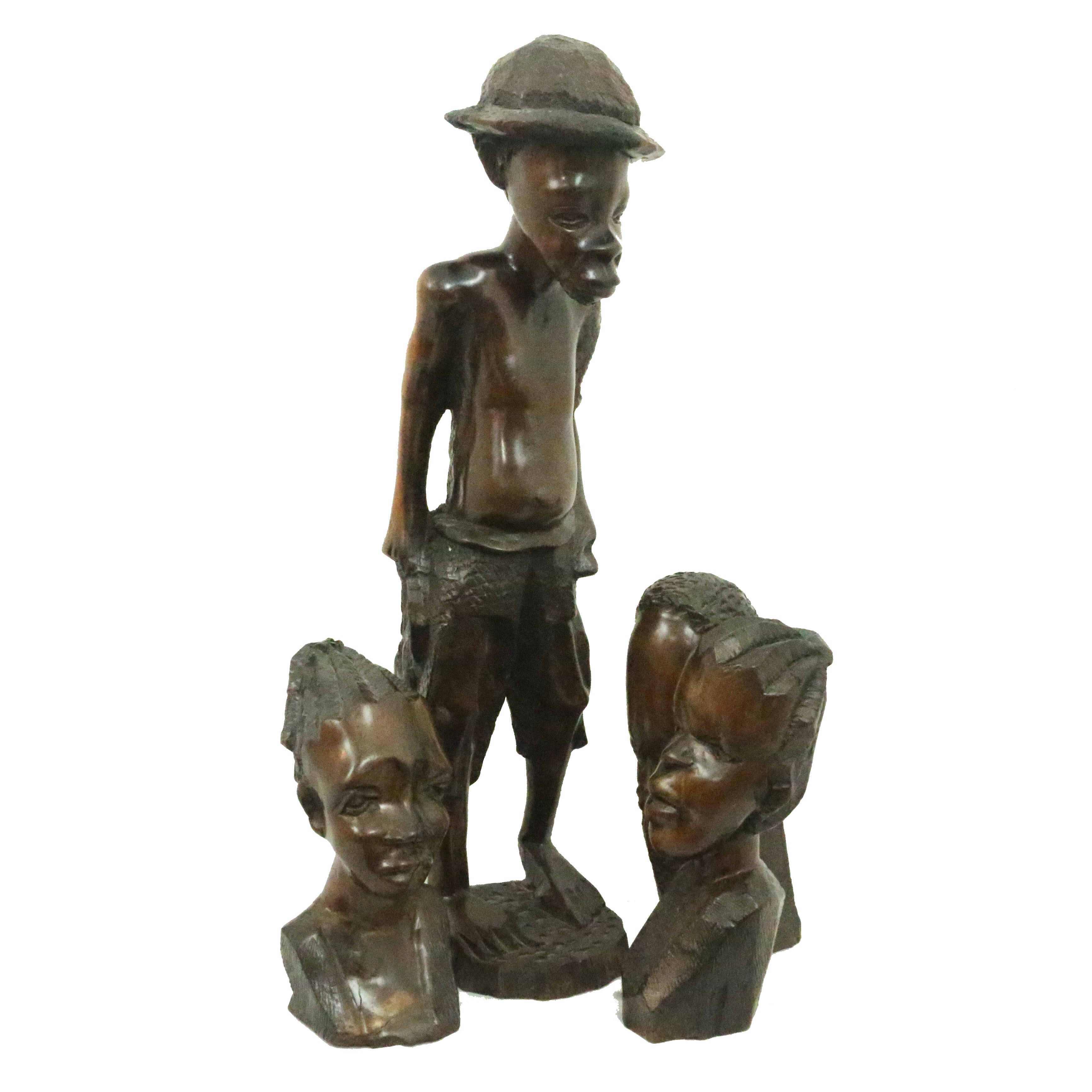 Four Carved Wooden Figures