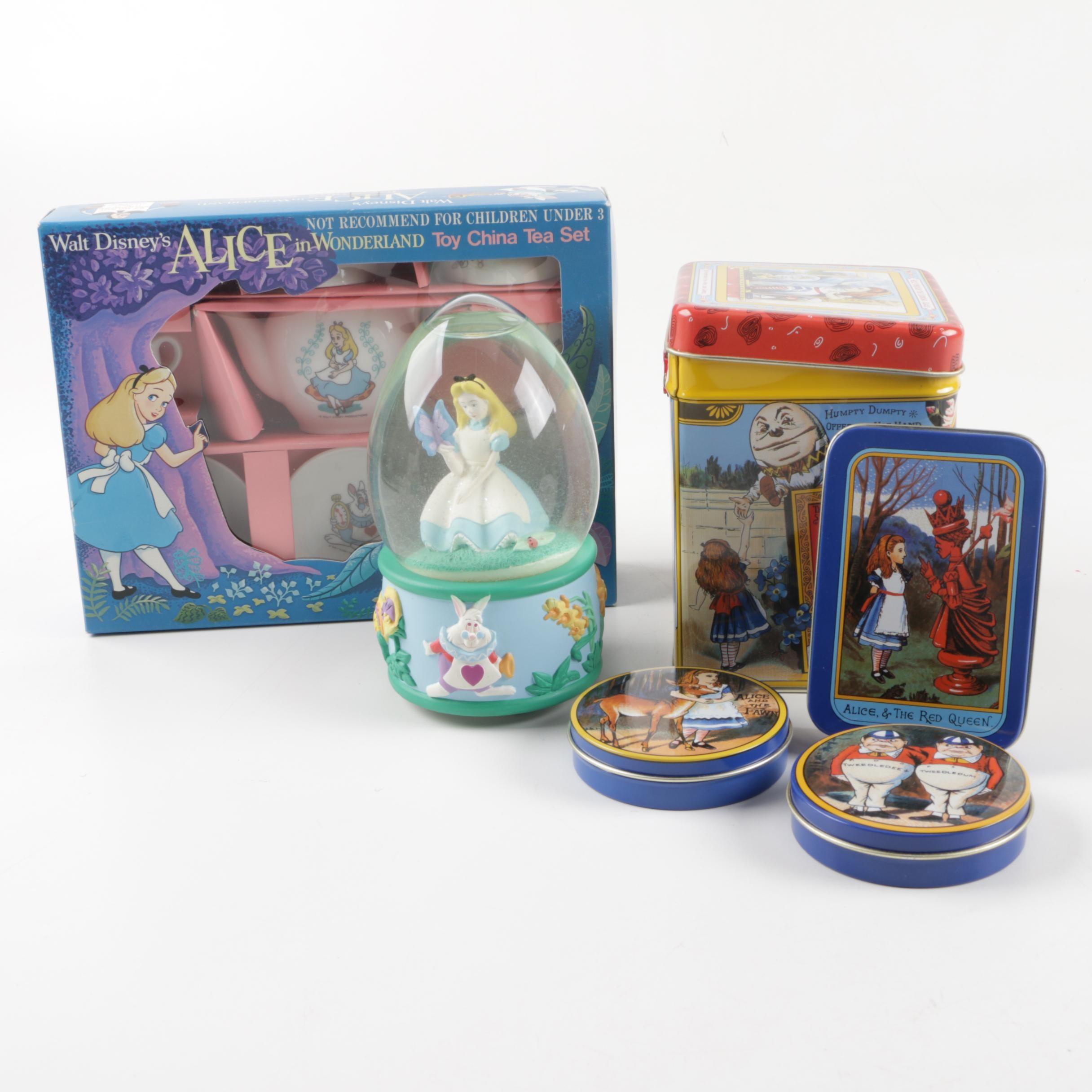 """Alice in Wonderland"" Decorative Tins, Snow Globe, and Tea Set"