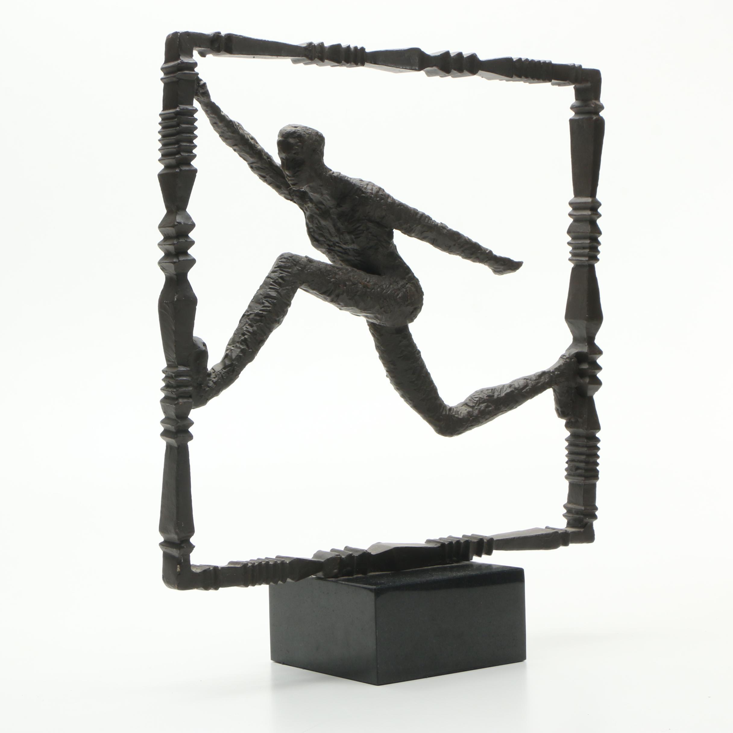 Iron Sculpture of a Figure Running
