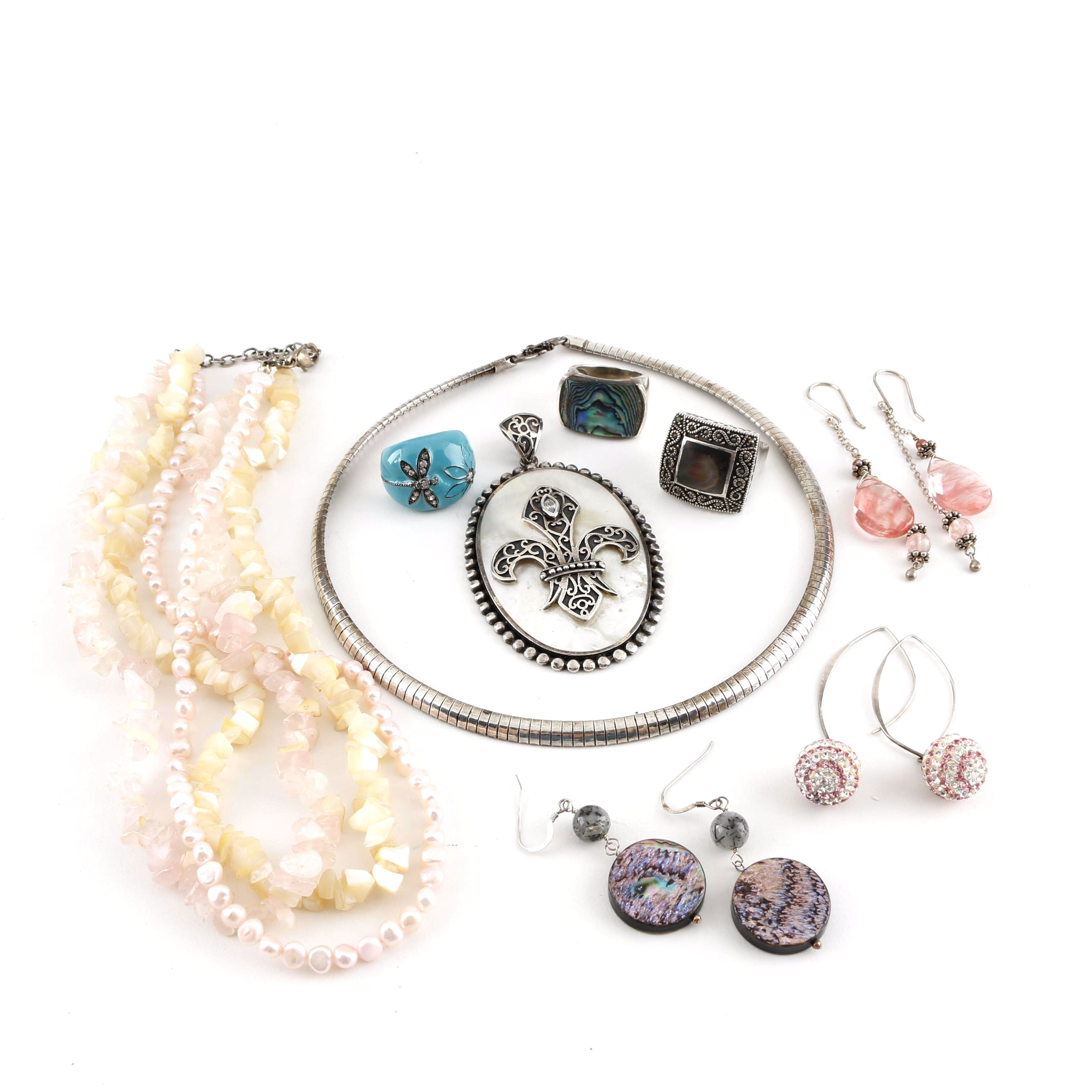 Assortment of Sterling Silver Jewelry Featuring Mother of Pearl and Abalone