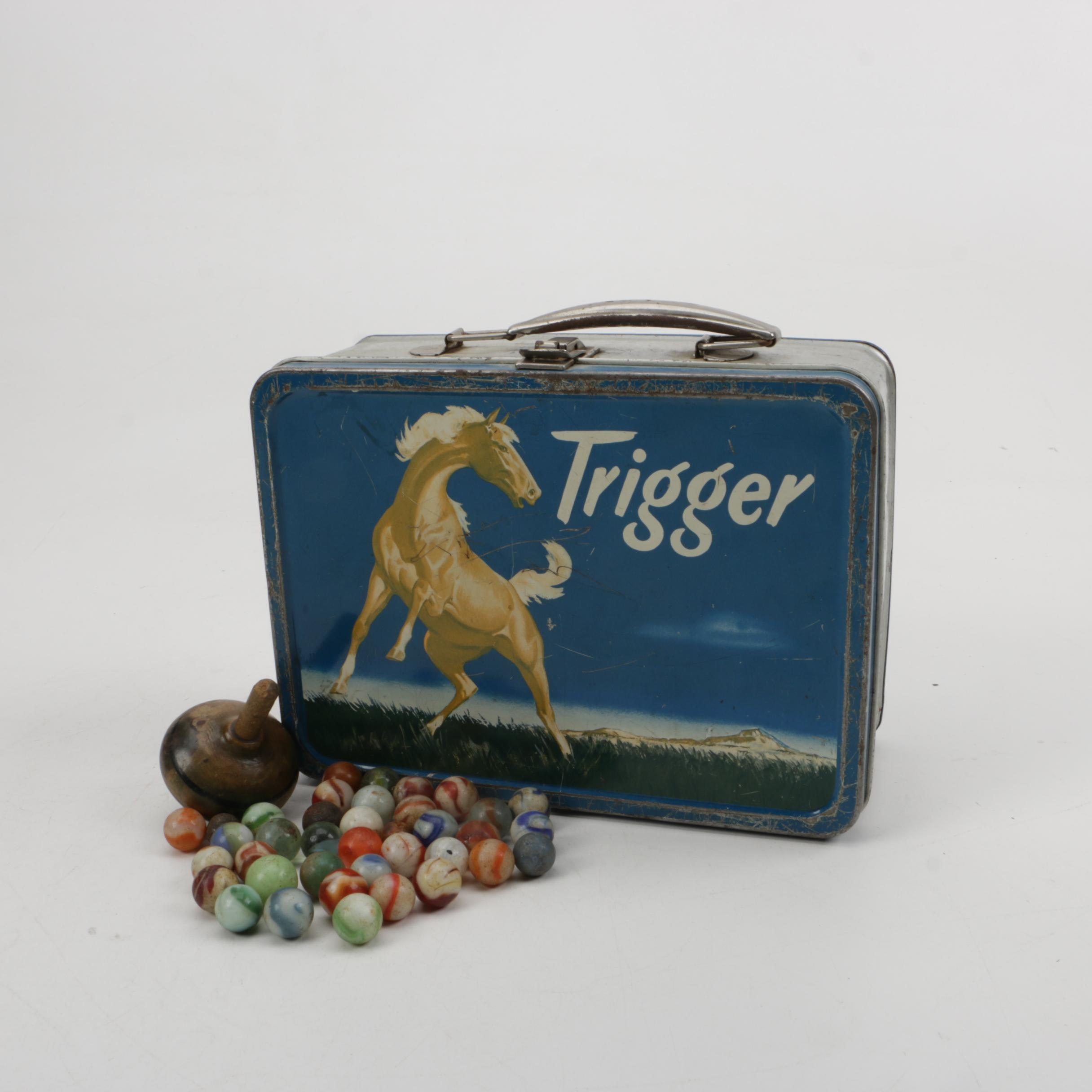 Trigger Lunch Box with Marbles and a Top