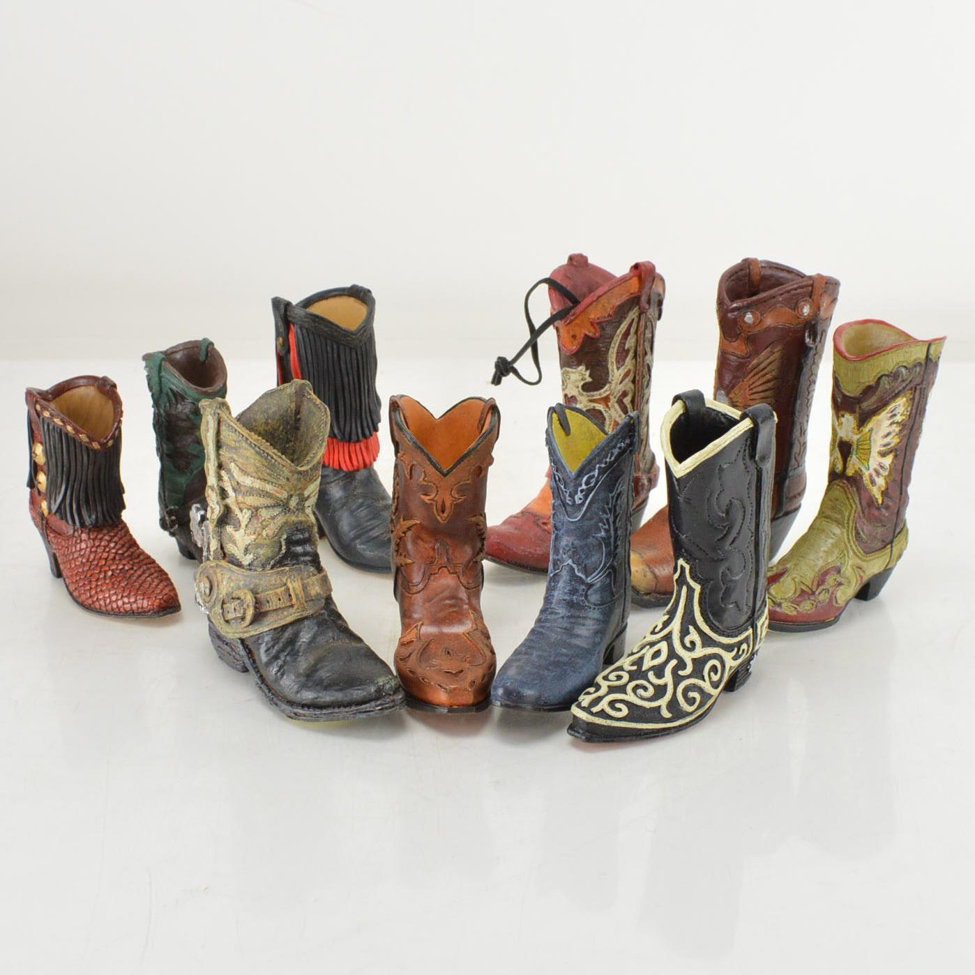 Collection of JPC Cowboy Boot Figurines