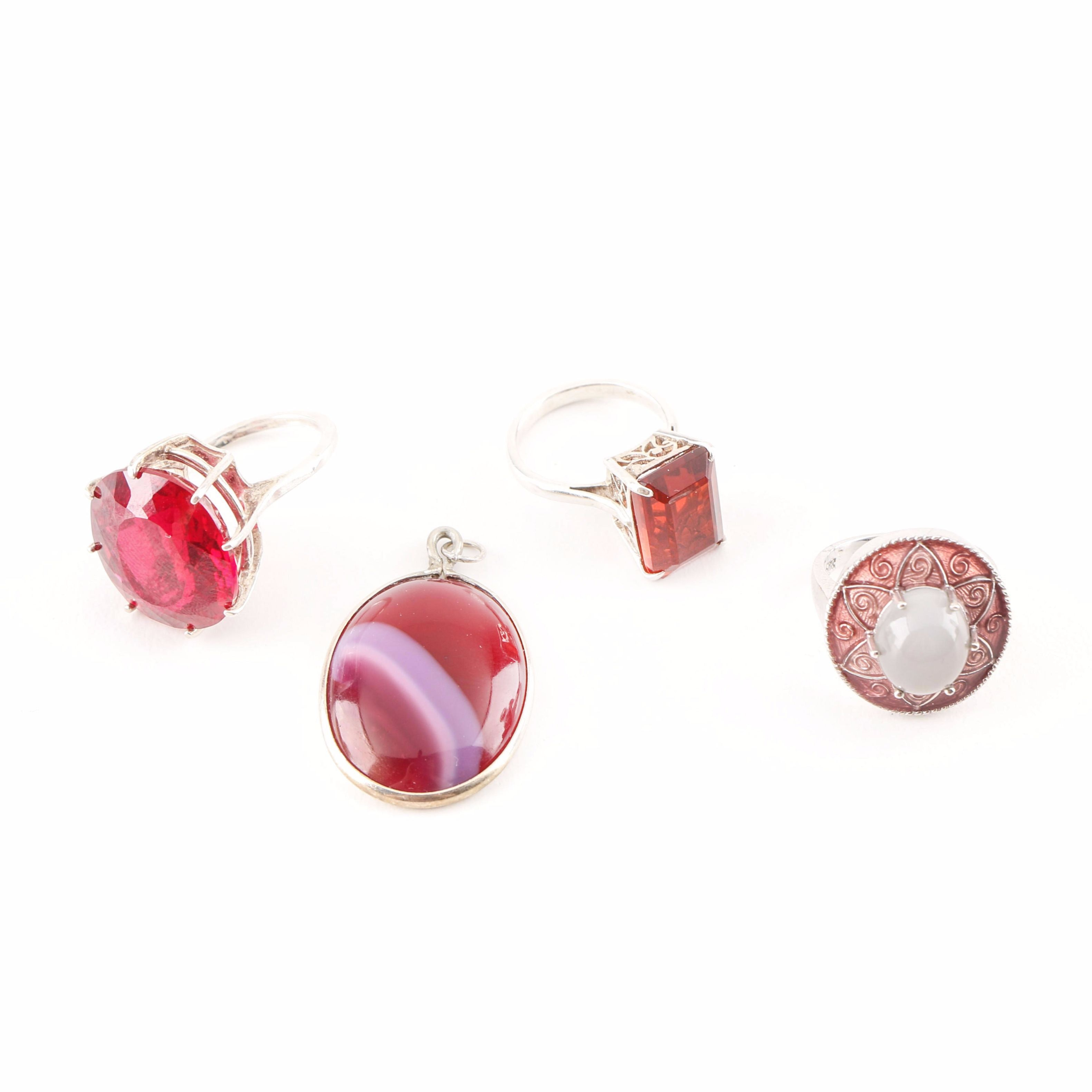 Grouping of Sterling Silver Rings and a Pendant With Accents