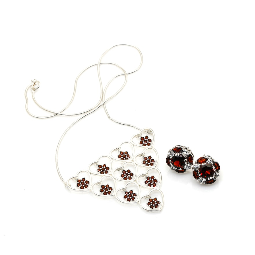 Sterling silver garnet pendant necklace and garnet and white topaz sterling silver garnet pendant necklace and garnet and white topaz earrings mozeypictures Image collections