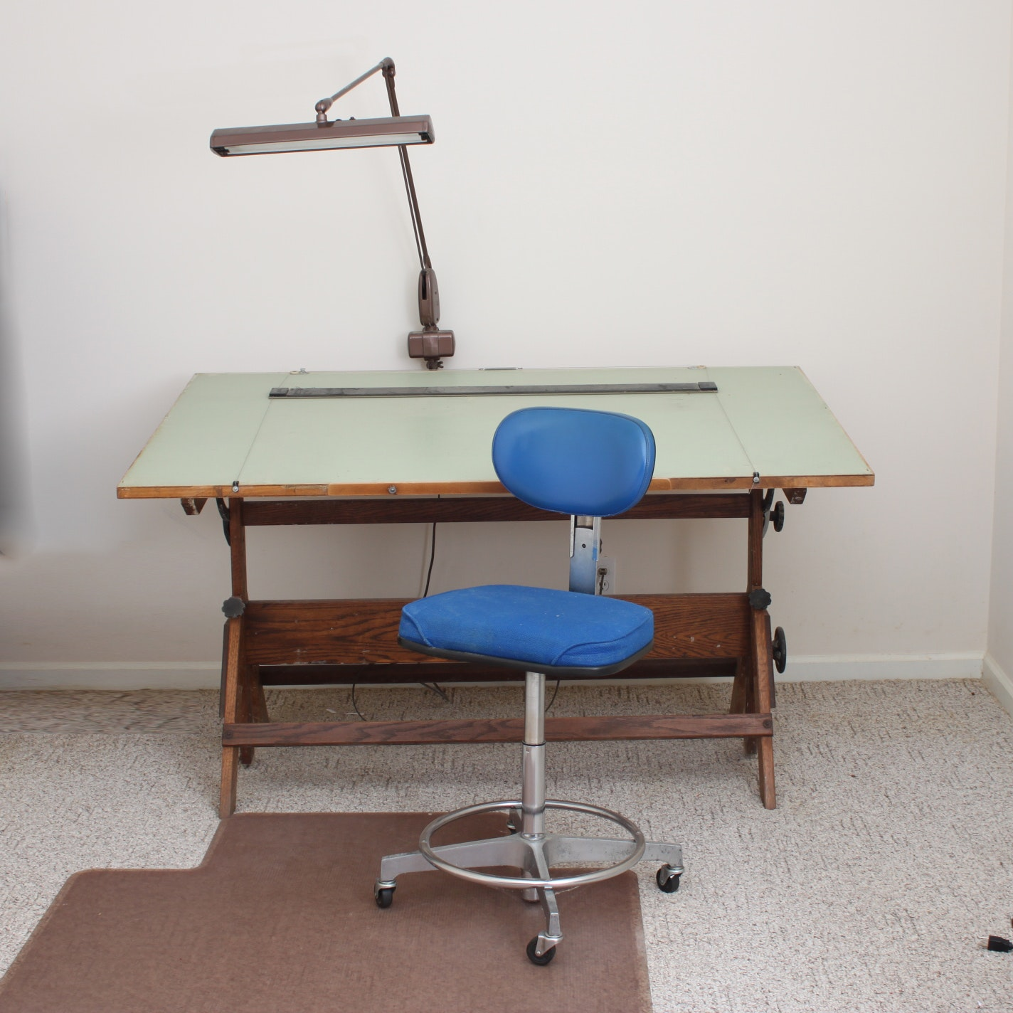 vintage drafting table with lamp and chair