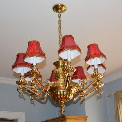 An eight arm brass chandelier