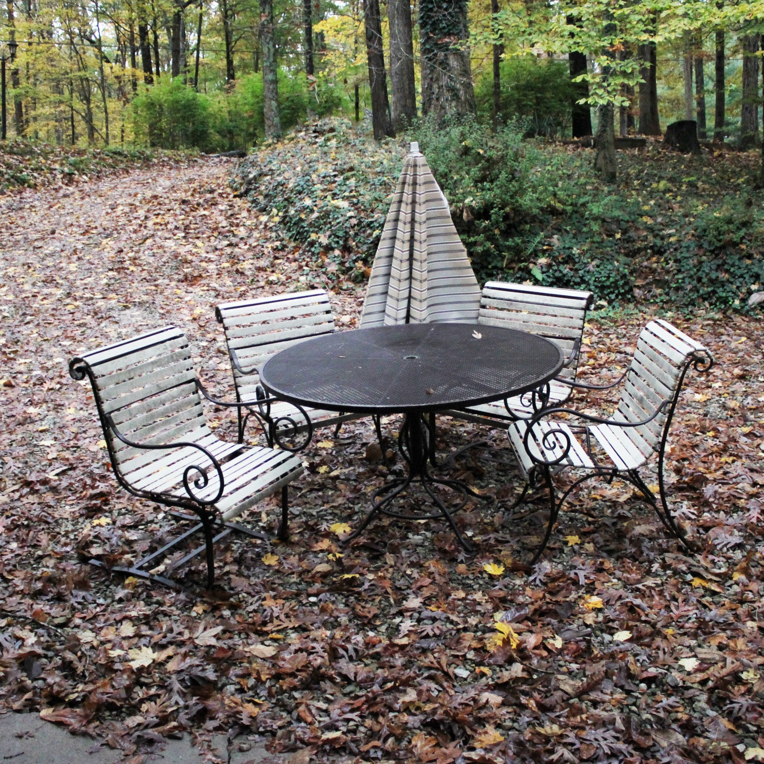 Metal Patio Table with Umbrella and Chairs