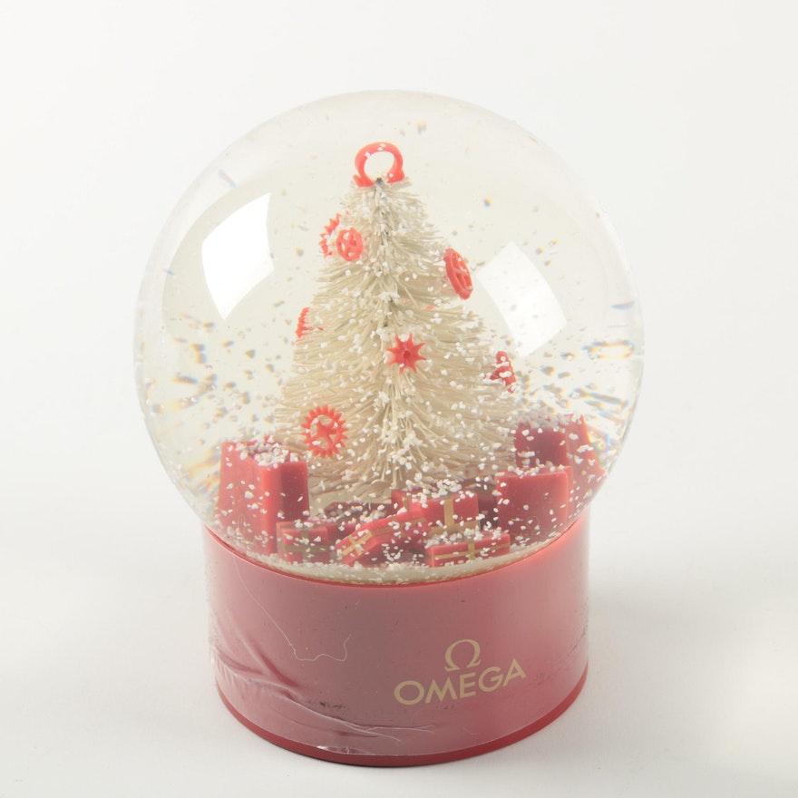 omega watch brand christmas tree snow globe