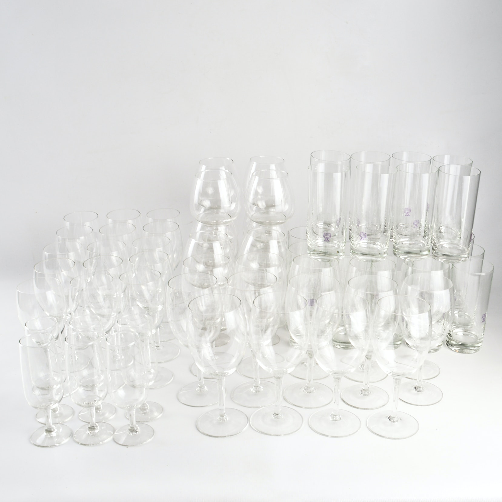 Generous Assortment of Clear Glass Barware
