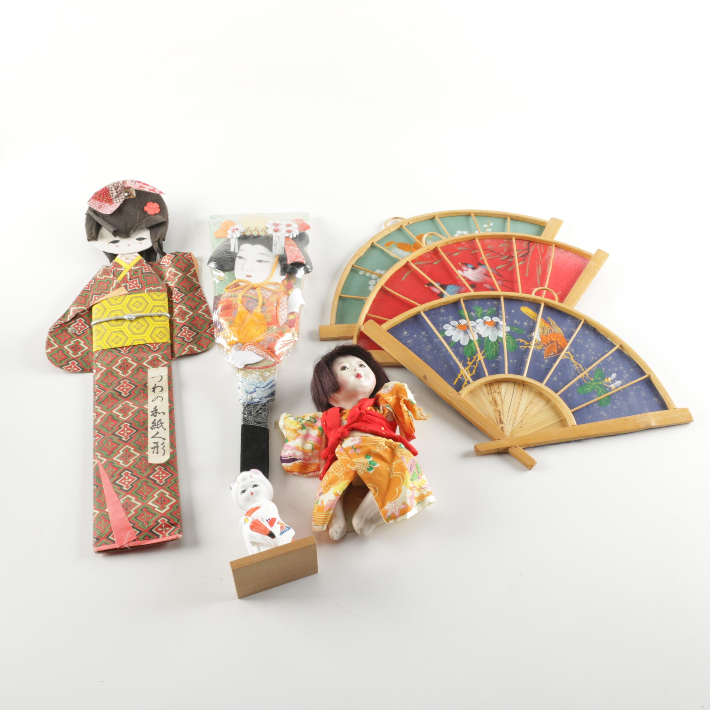 Japanese Figurines and Hand-Painted Fan Wall Hangings