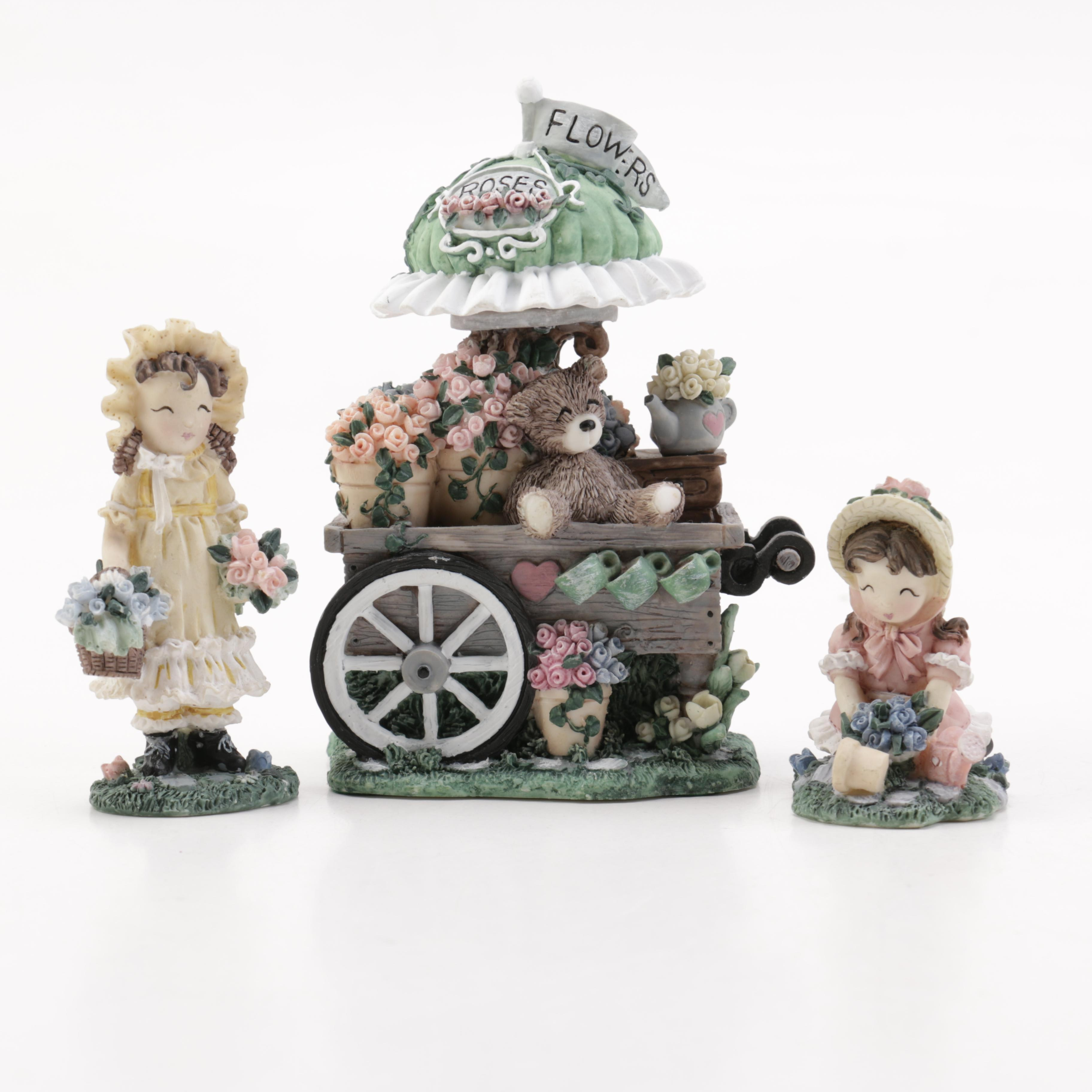Ivy & Innocence Figurines Featuring Blossom's Flower Cart
