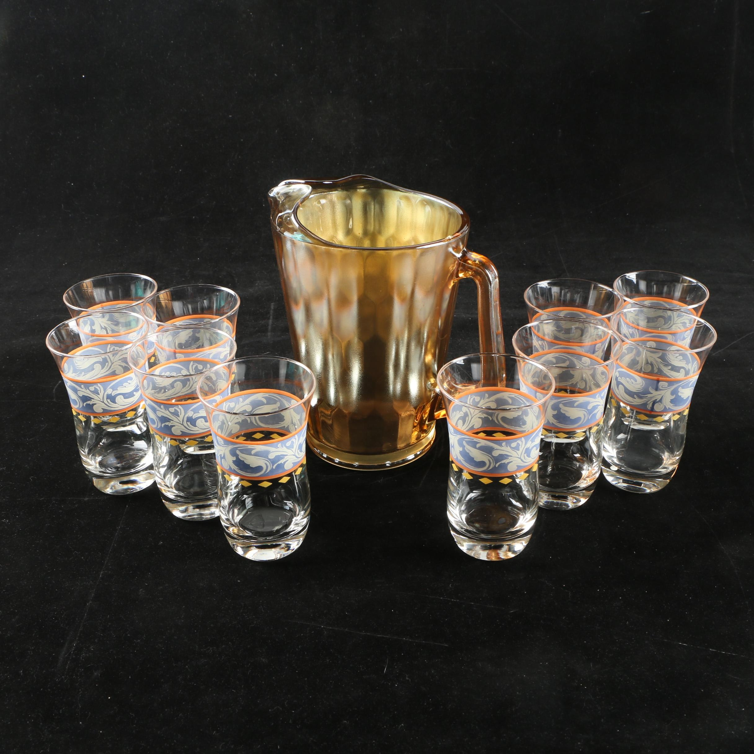 Amber Carnival Glass Pitcher and Foliate Motif Tumblers