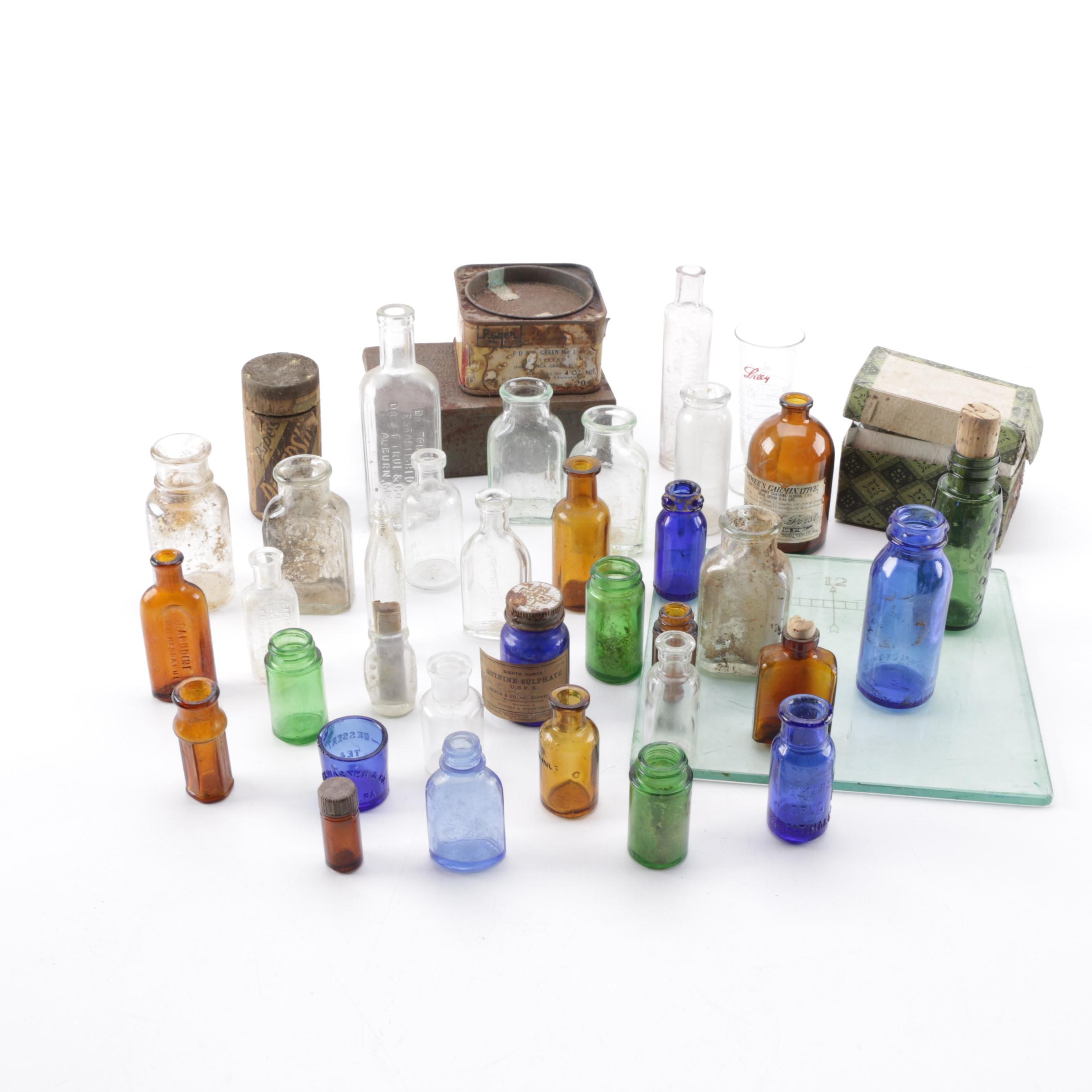 Assortment of Glass Bottles and Metal Tins
