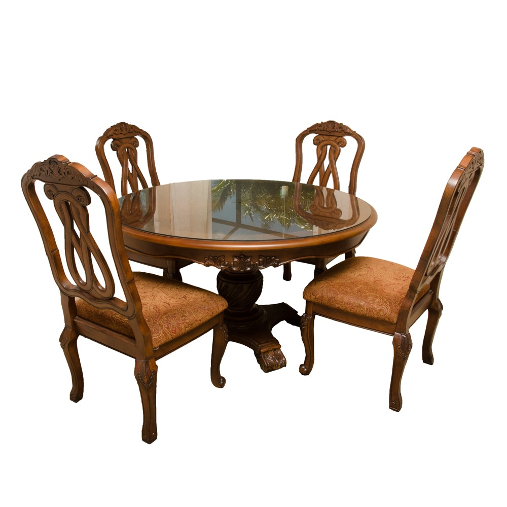 """North Shore"" Dining Table and Four Chairs by Ashley Furniture"