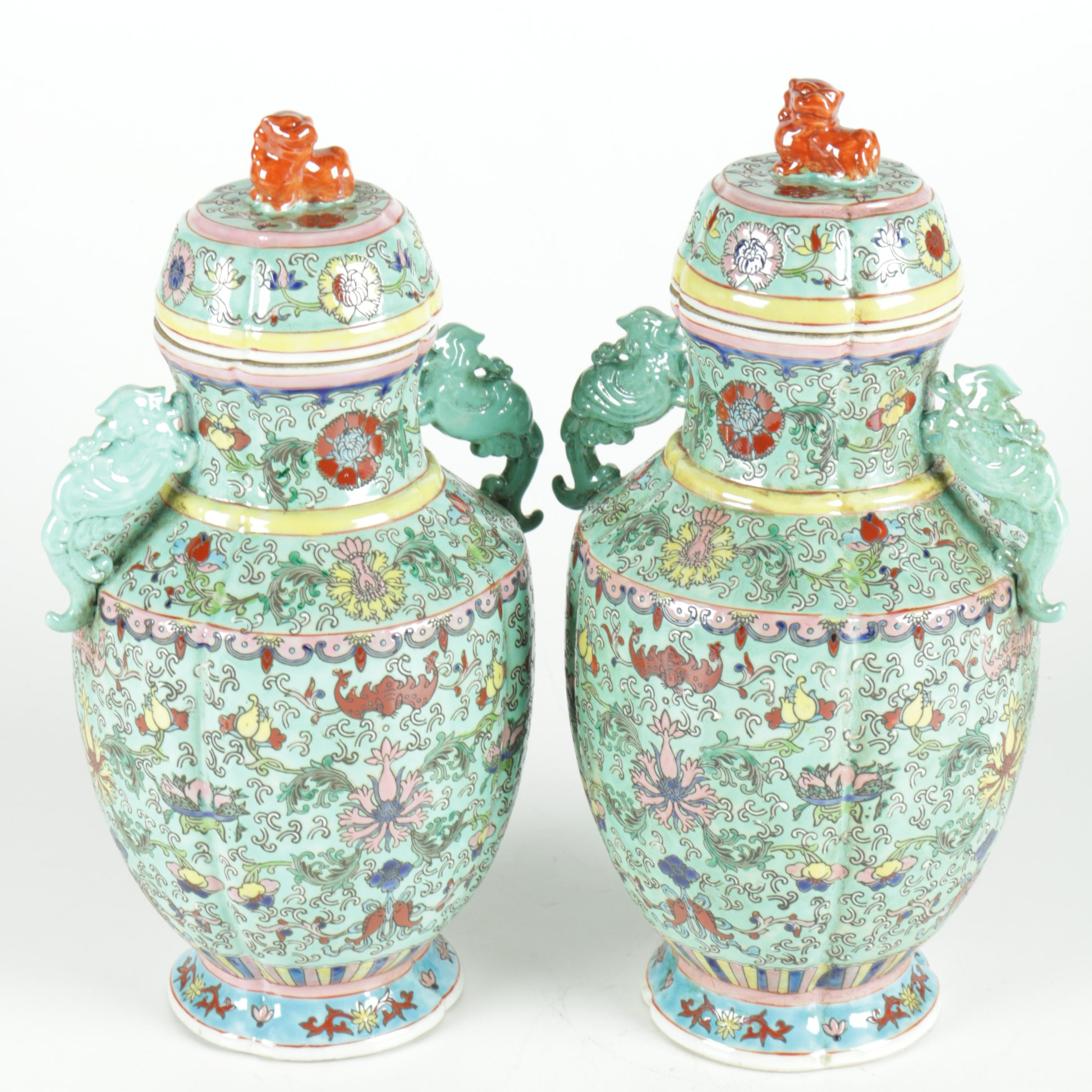 Pair of Famille Verte Jars With Guardian Lions Finials