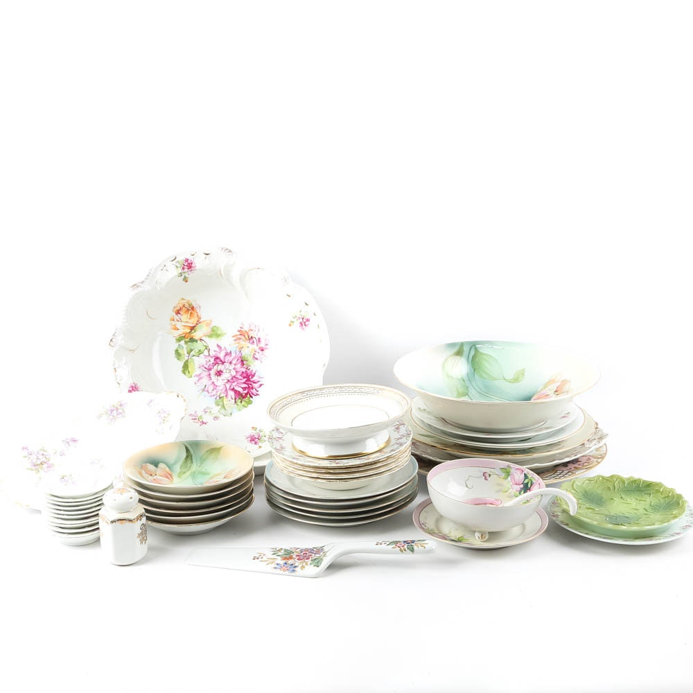 Large Assortment of Mismatched China Plates and Serving Pieces