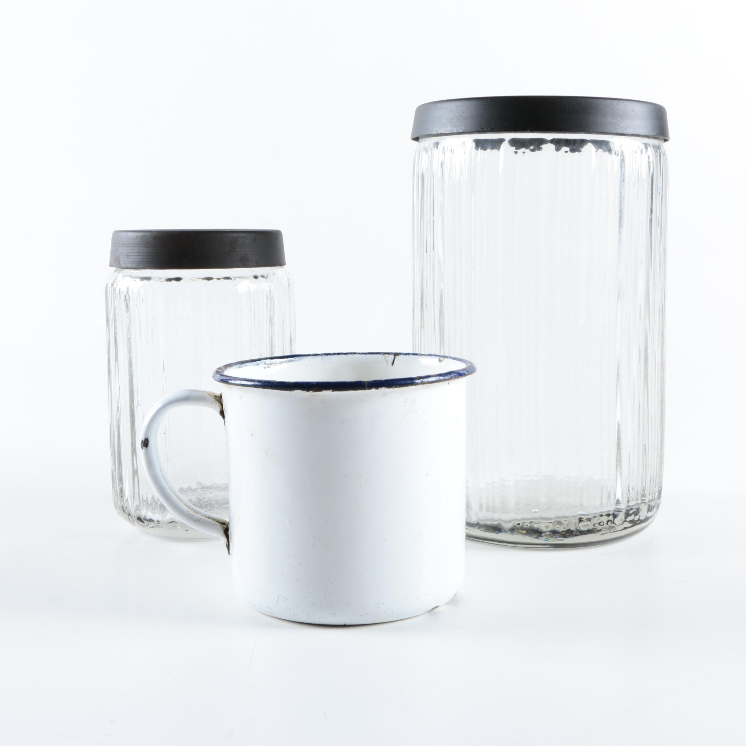 Glass and Metal Kitchen Canisters and Enamelware Mug