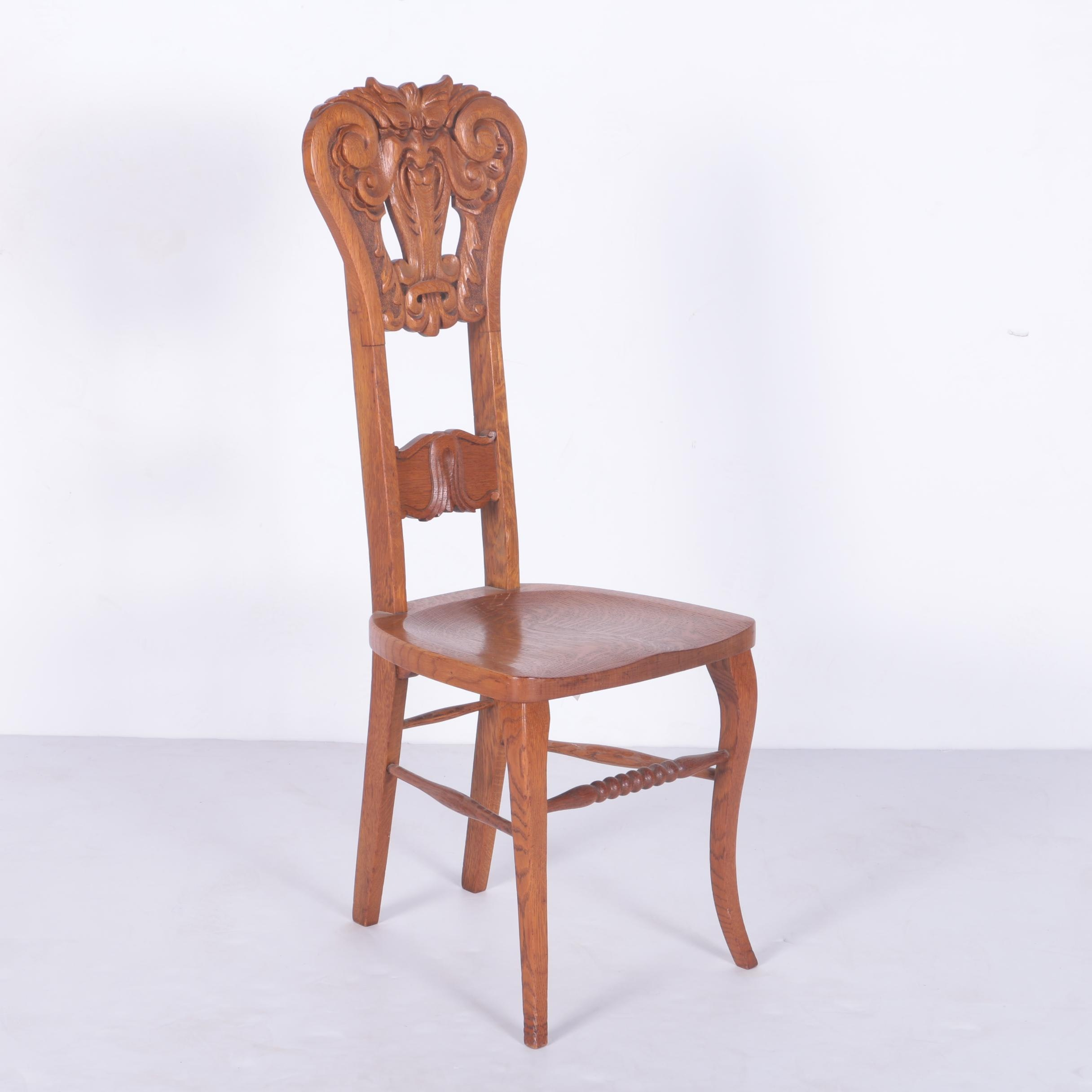 North Wind Carved Oak Chair