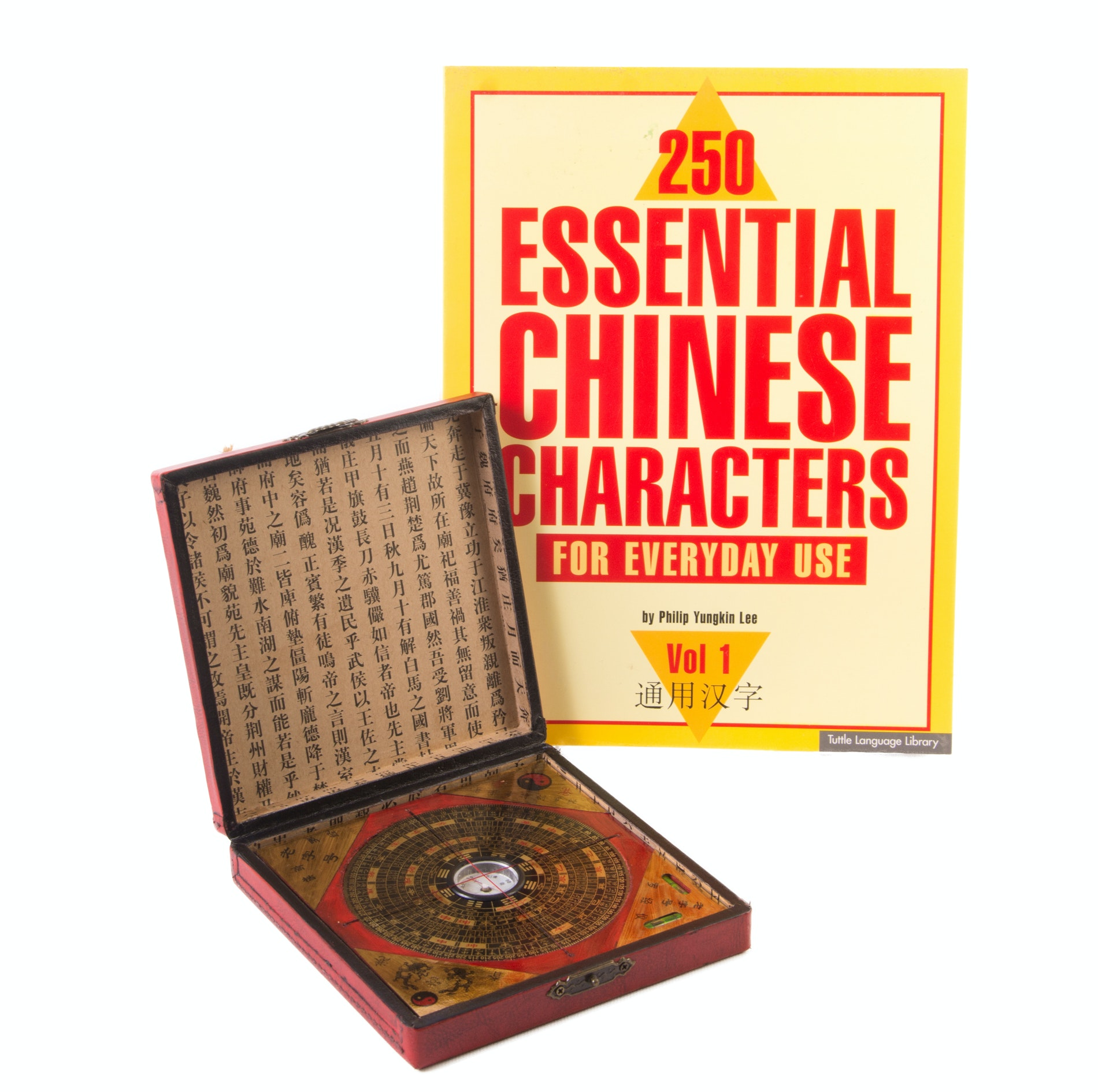 Chinese Writing Book and Feng Shui Compass and