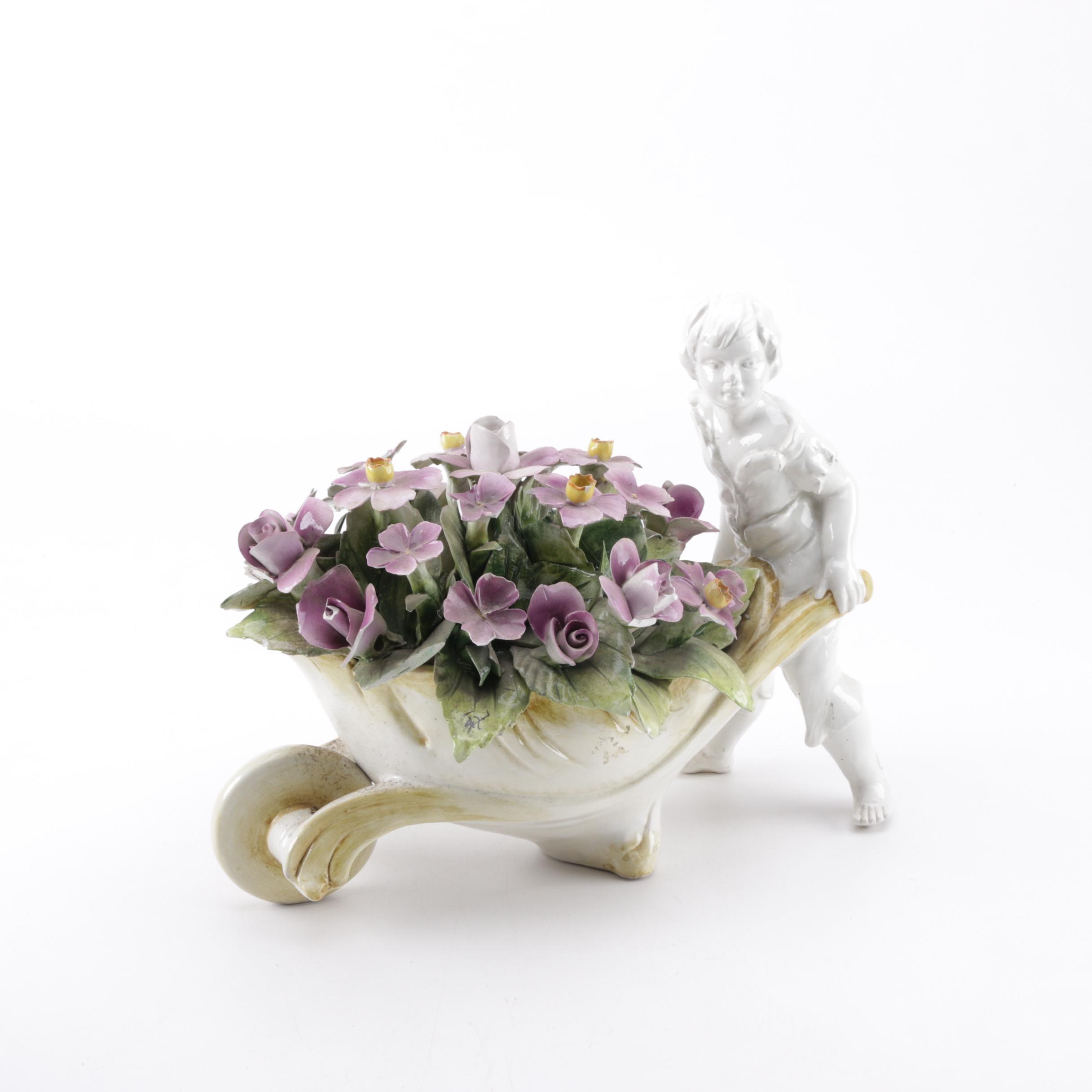 Ceramic Figurine with Wheelbarrow of Flowers