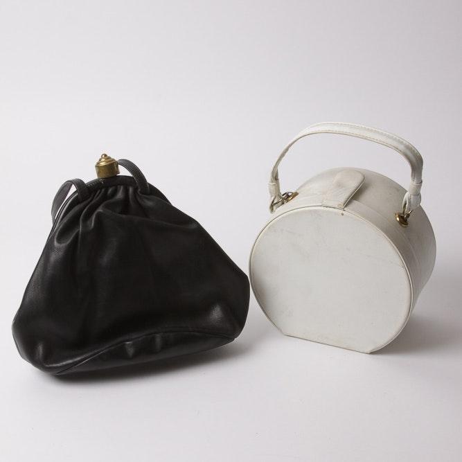 Black Bucket Bag and Round White Handbag