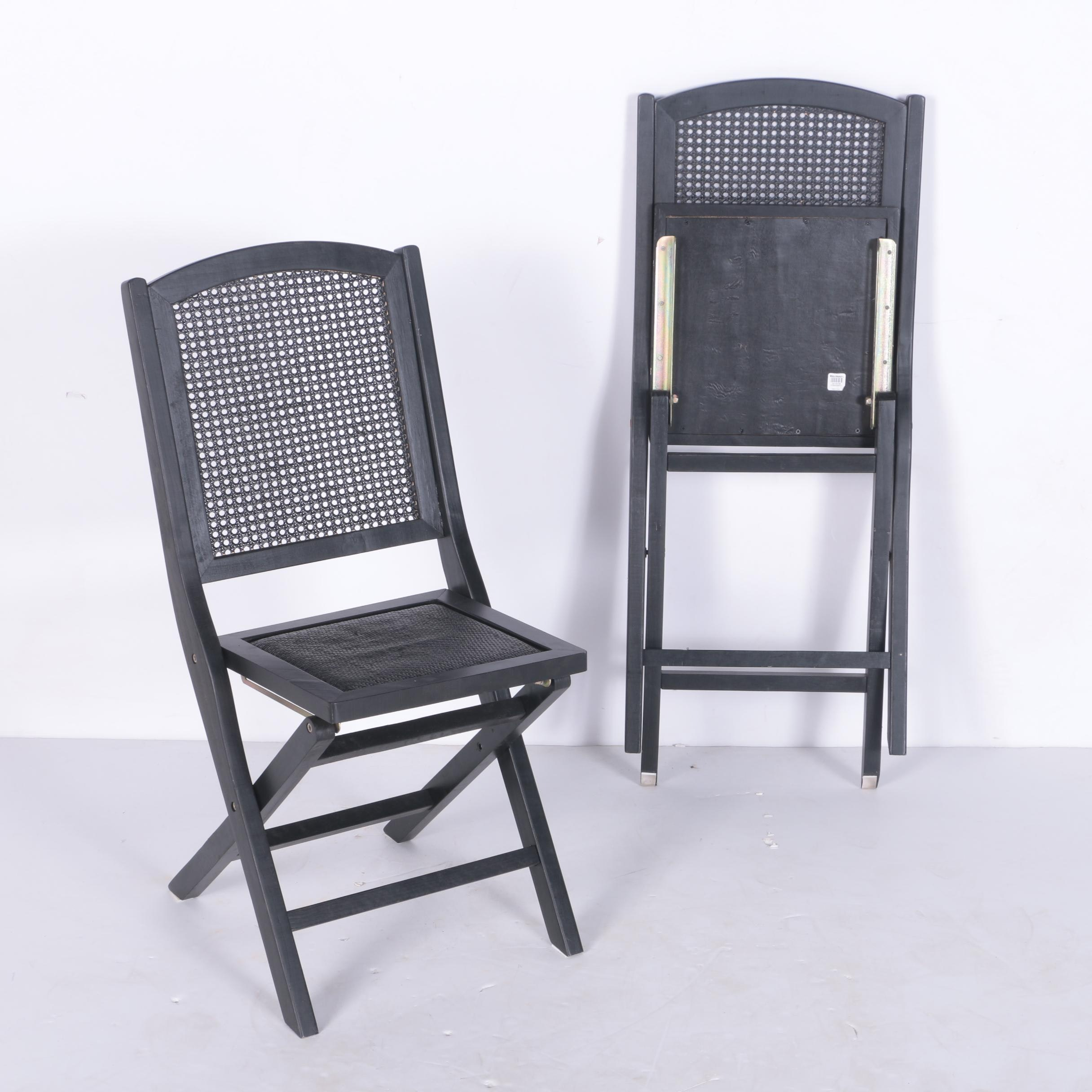 Two Folding Wood Chairs with Caned Backs