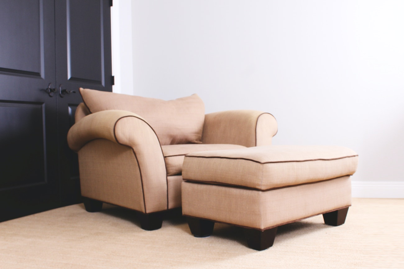 Matching Upholstered Armchair and Ottoman