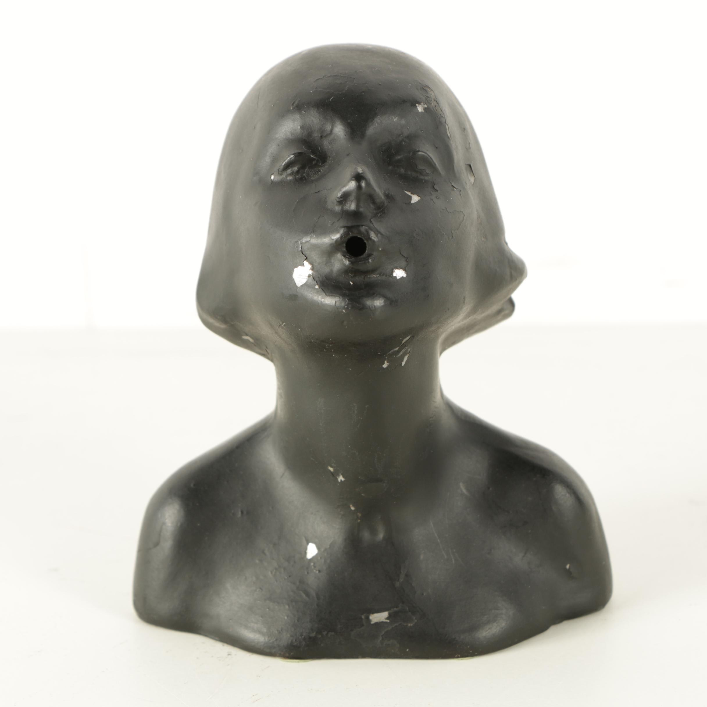 Vintage Cast Lead Alloy Sculpture of a Woman with Pursed Lips