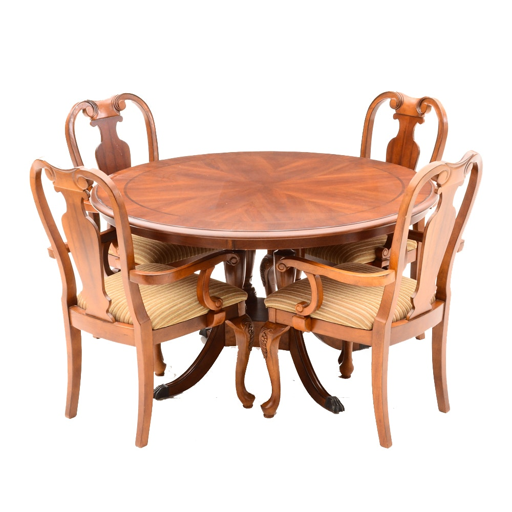 Pedestal Dining Table and Chairs by Ashley Furniture