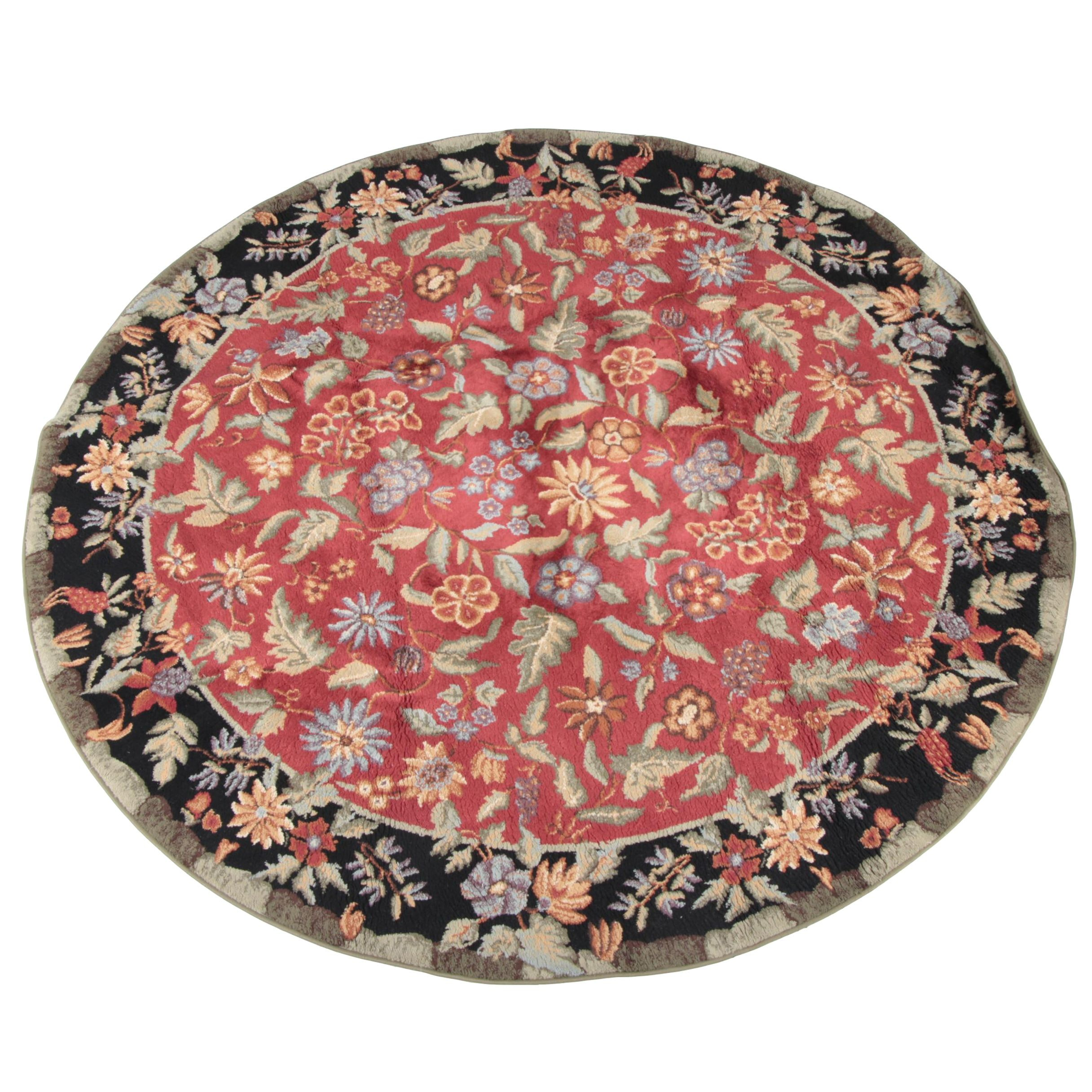 Power-Loomed Floral Round Wool Area Rug.
