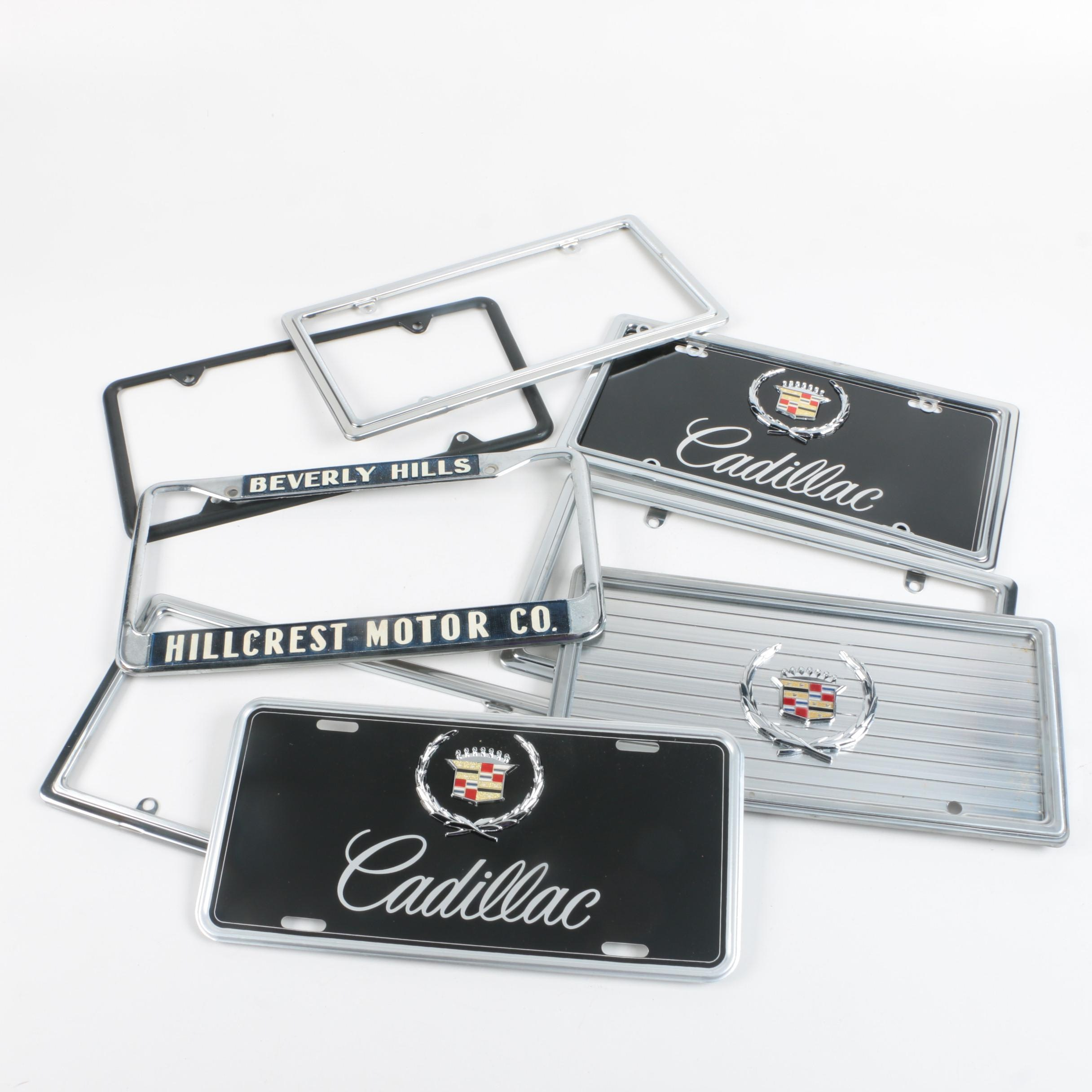 Assortment of License Plate Holders including Cadillac Plates