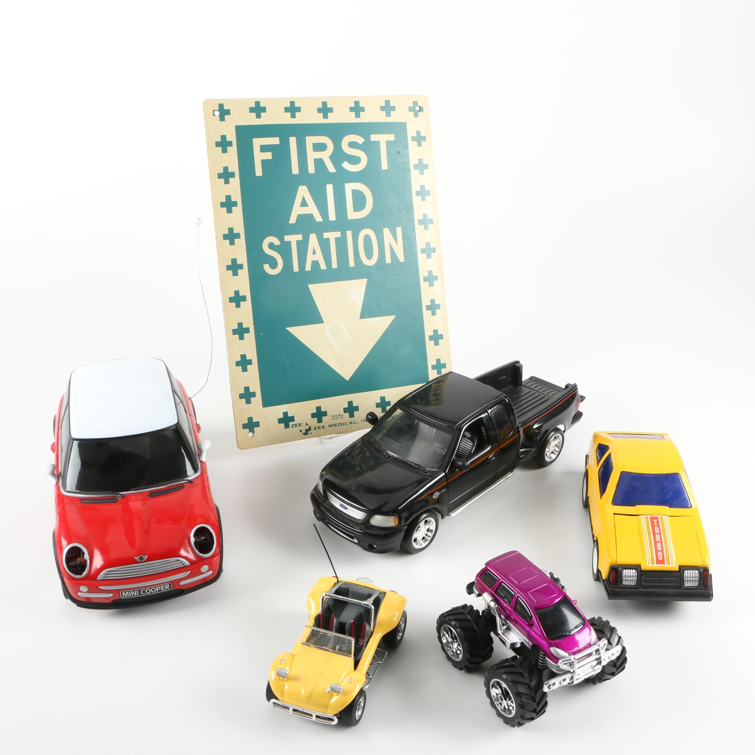 """Assorted Die-Cast Cars and """"First Aid Station"""" Sign"""