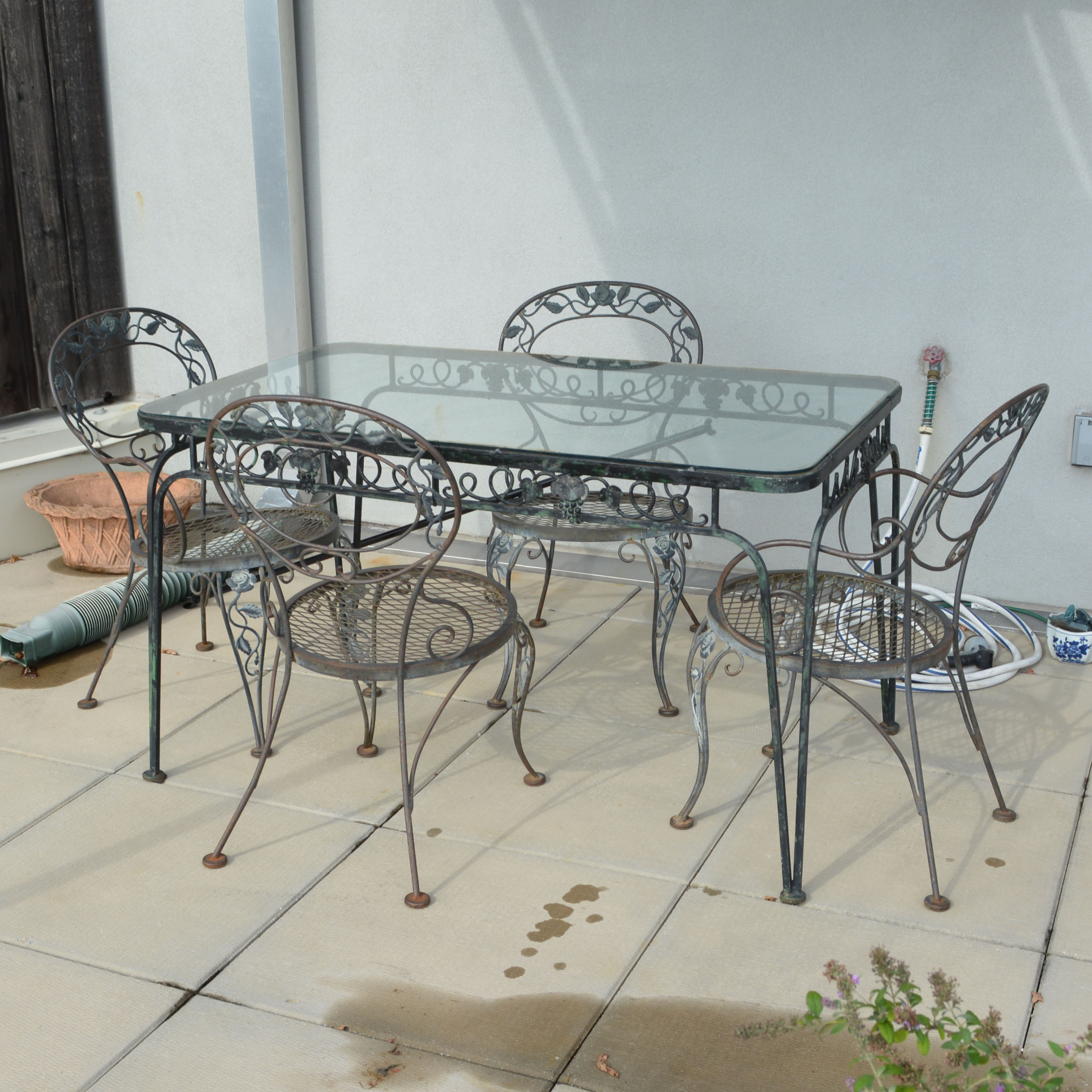 Glass-Top Wrought Iron Patio Table with Chairs