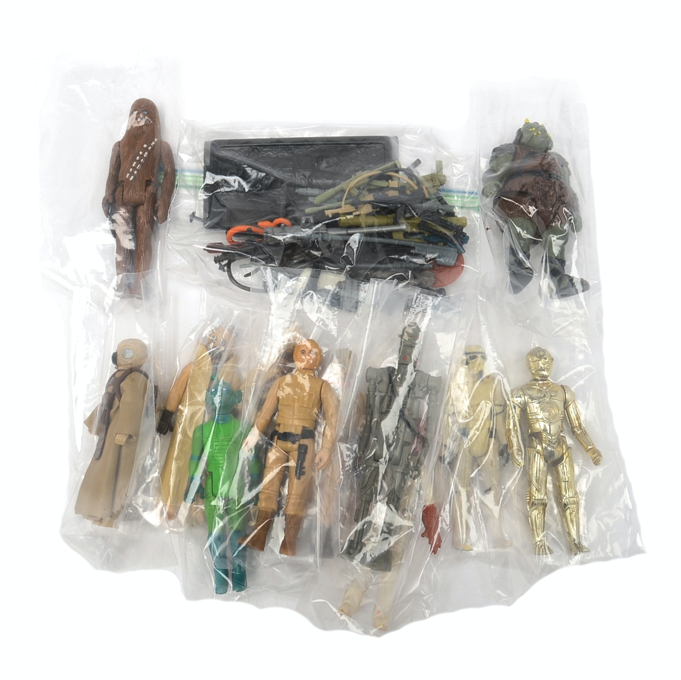 Collection of Vintage Star Wars Figures and Weapons